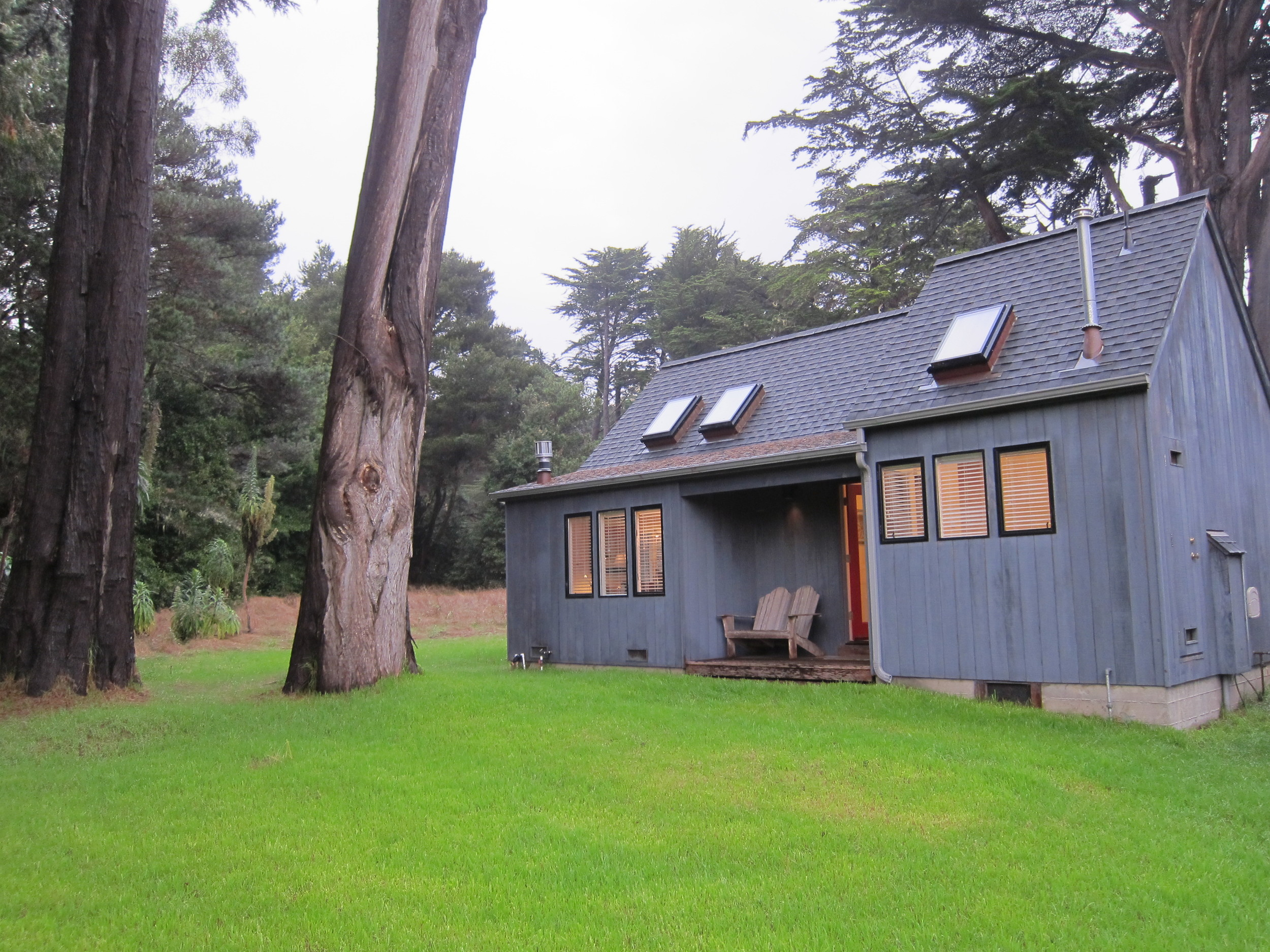 rachel's cottage from the west, with cypress trees