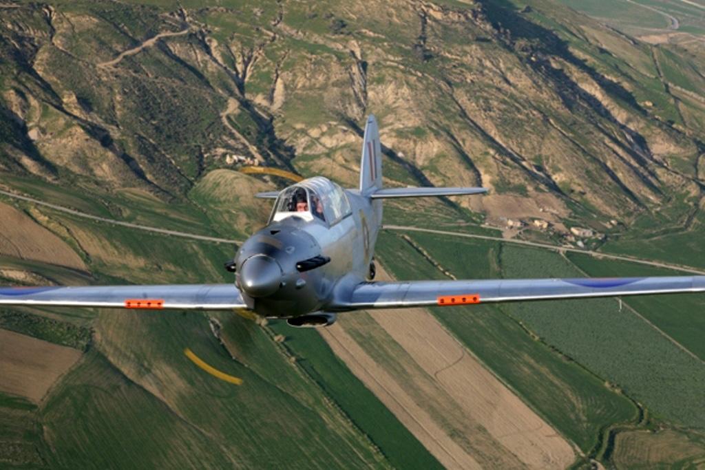 Flying Legend's Hurricane Replica in flight over Italy