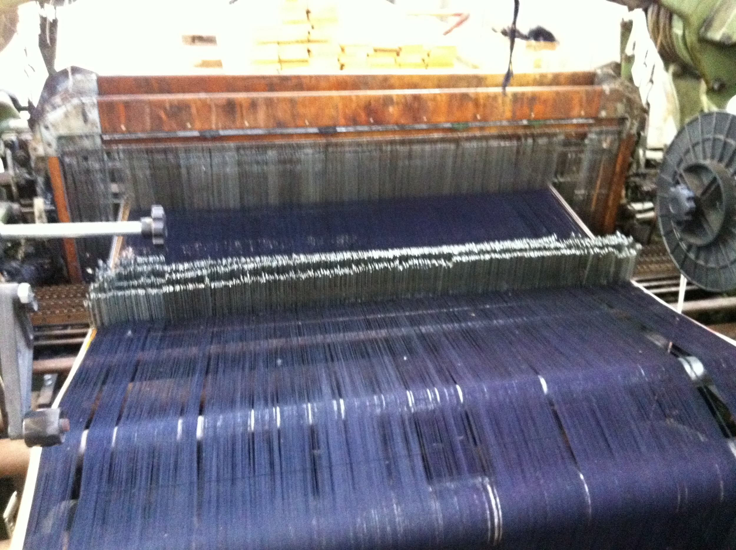 Indigo warp (with white selvedge) set up on beautiful vintage looms.
