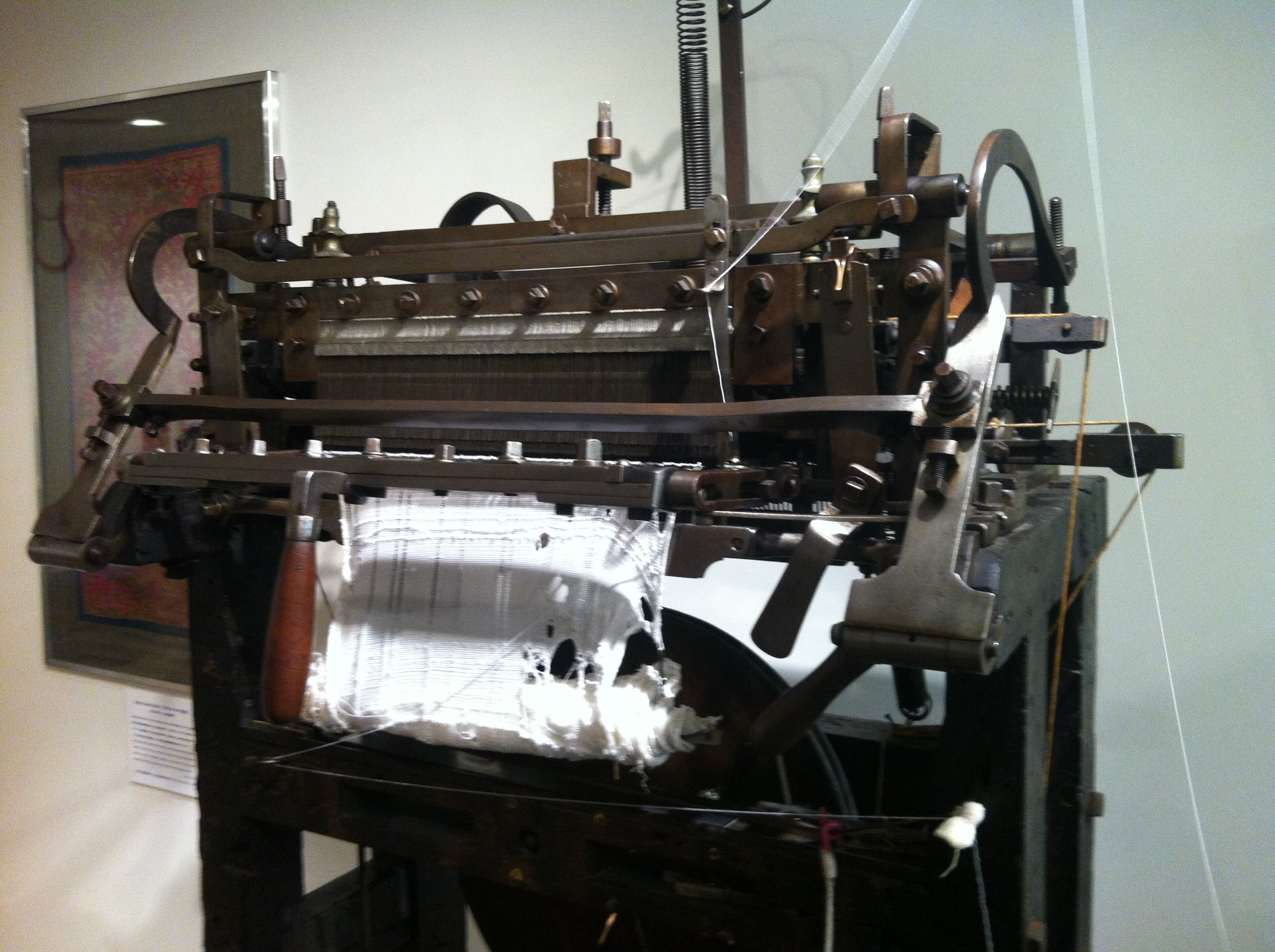 A stocking frame machine built around 1860 still functions (somewhat) at the Shima Seiki Museum in Wakayama, Japan.