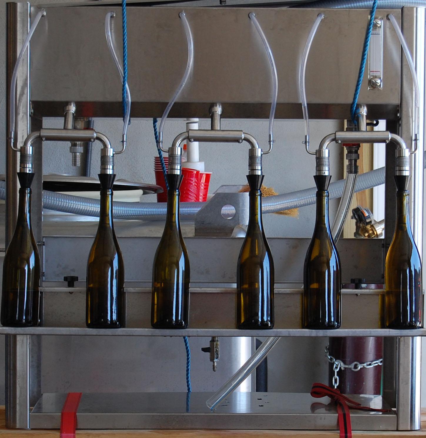 Six-spout bottler filling Orion