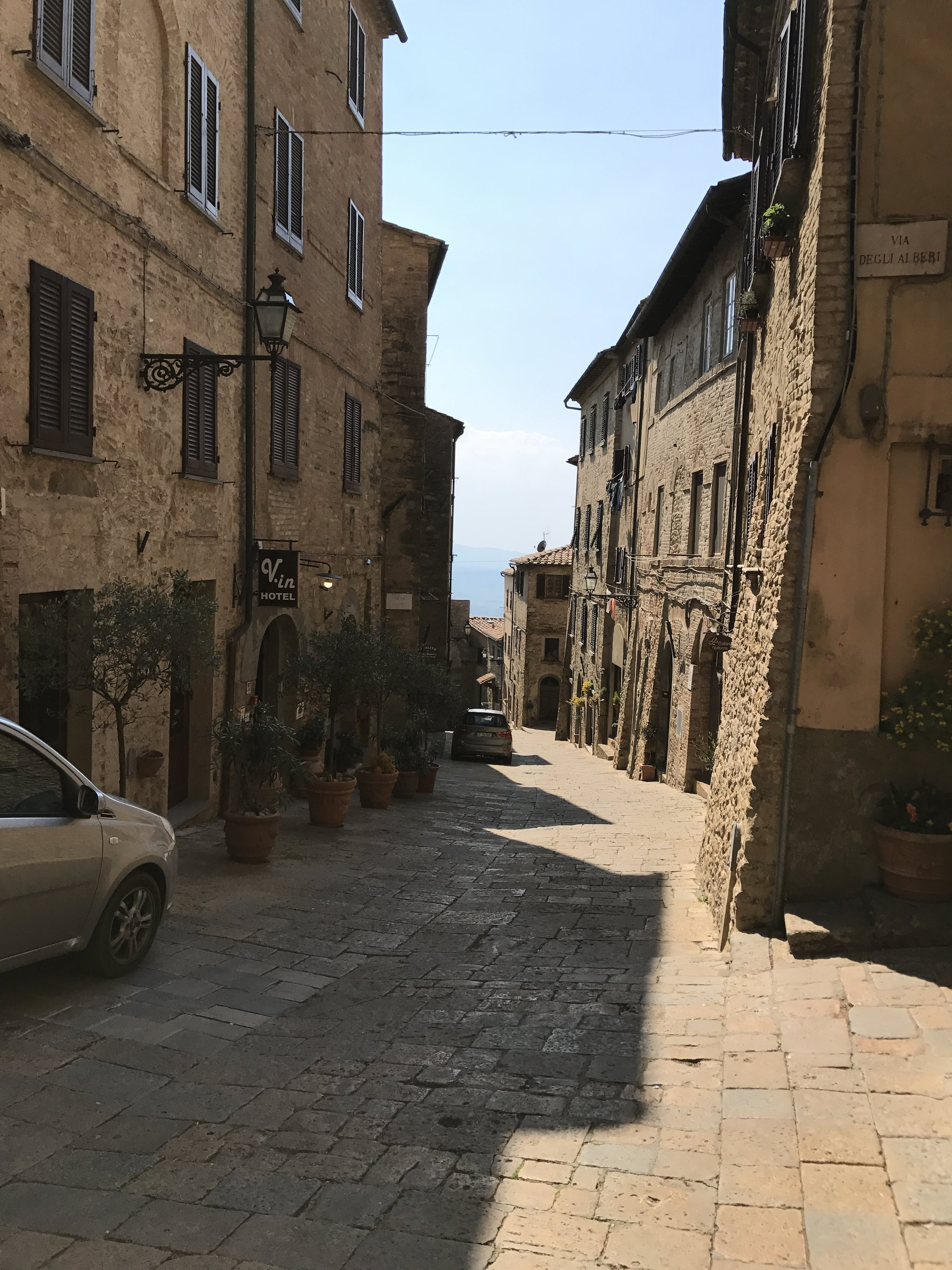 Steep street view, typical of the hilltowns, in Volterra.