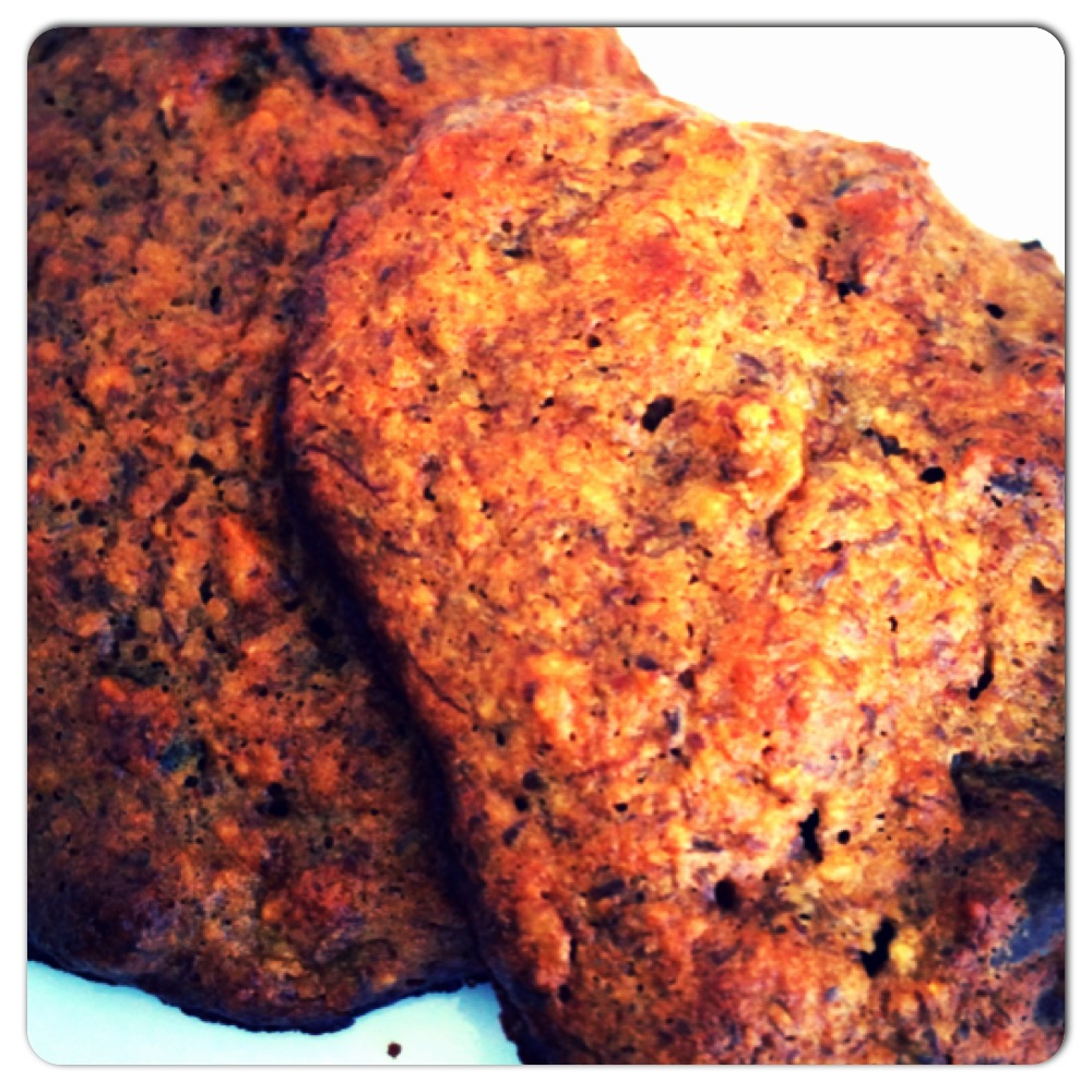 Ingredients:    2 medium ripe bananas    2 eggs (or 2 Tbsp flaxseed + 5 Tbsp water, for my egg-free friends)    ½ cup raw almond butter    2 Tbsp coconut oil, melted    1 tsp pure vanilla extract    3 Tbsp raw organic honey (sub agave nectar or maple syrup)    1 ½ cup gluten free rolled oats    ½ cup flaxseed meal flour    ½ cup almond meal flour    ½ tsp baking powder    ½ tsp baking soda   Pinch sea salt  3 Tbsp crushed raw walnuts (or sub any other nut)   *Option: ½ cup carob chips, for more decadence