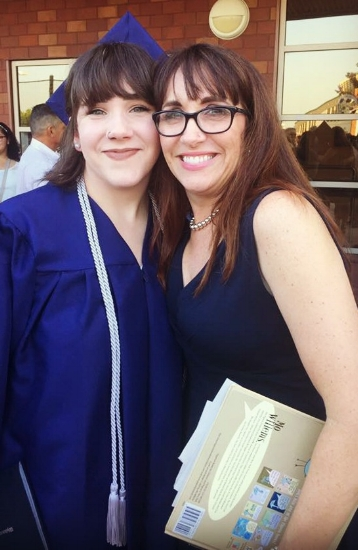 Daughter's high school graduation, May 2017  - Note the Mo Willems children's book, which is what happens when your 4th child graduates and the little special needs brother has to sit through the ceremony. :D
