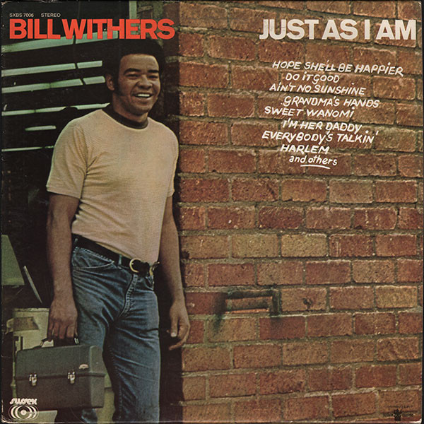 Bill's first album, standing outside his workplace.