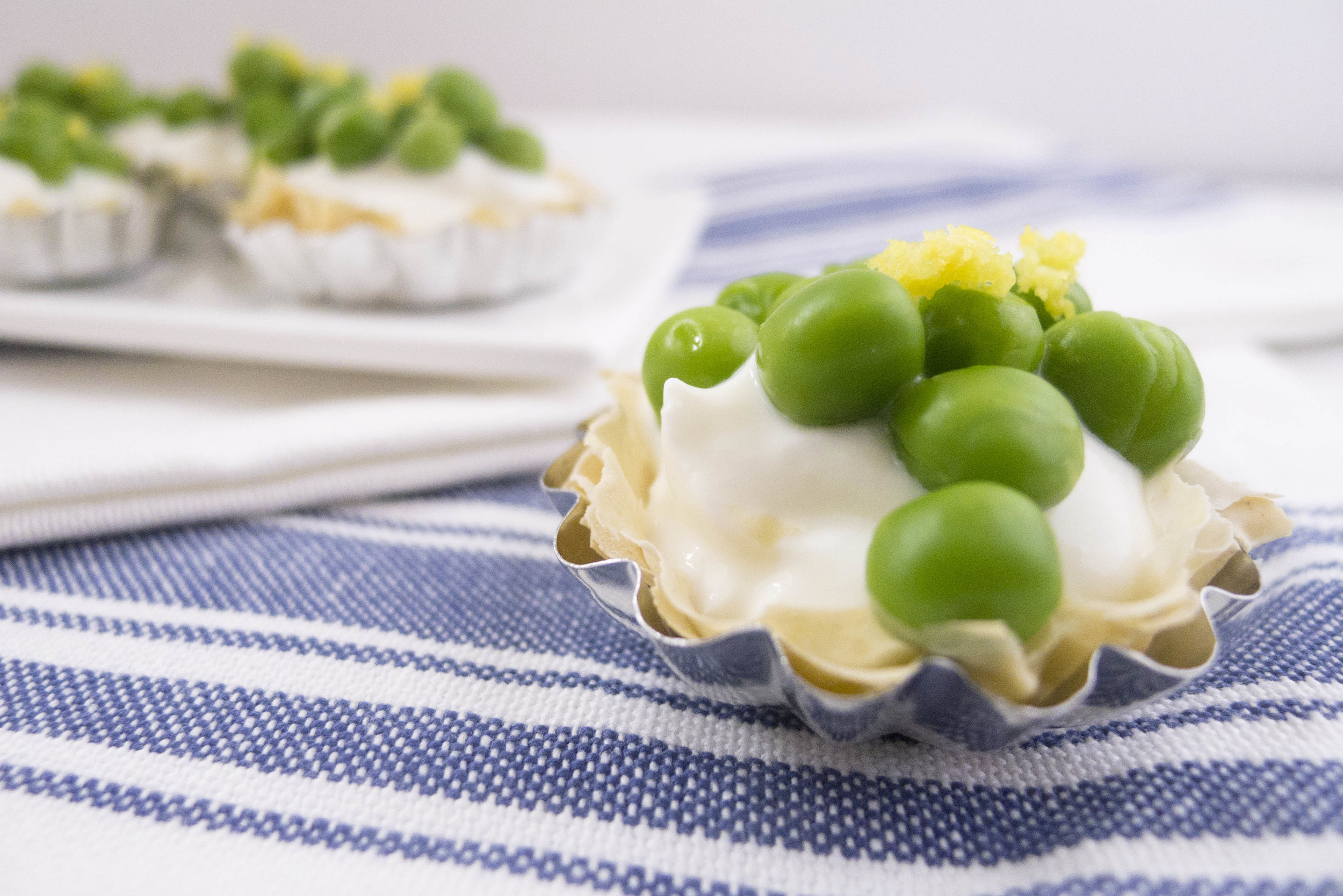 Light goat cheese and greek yogurt phyllo dough tart with spring peas and lemon