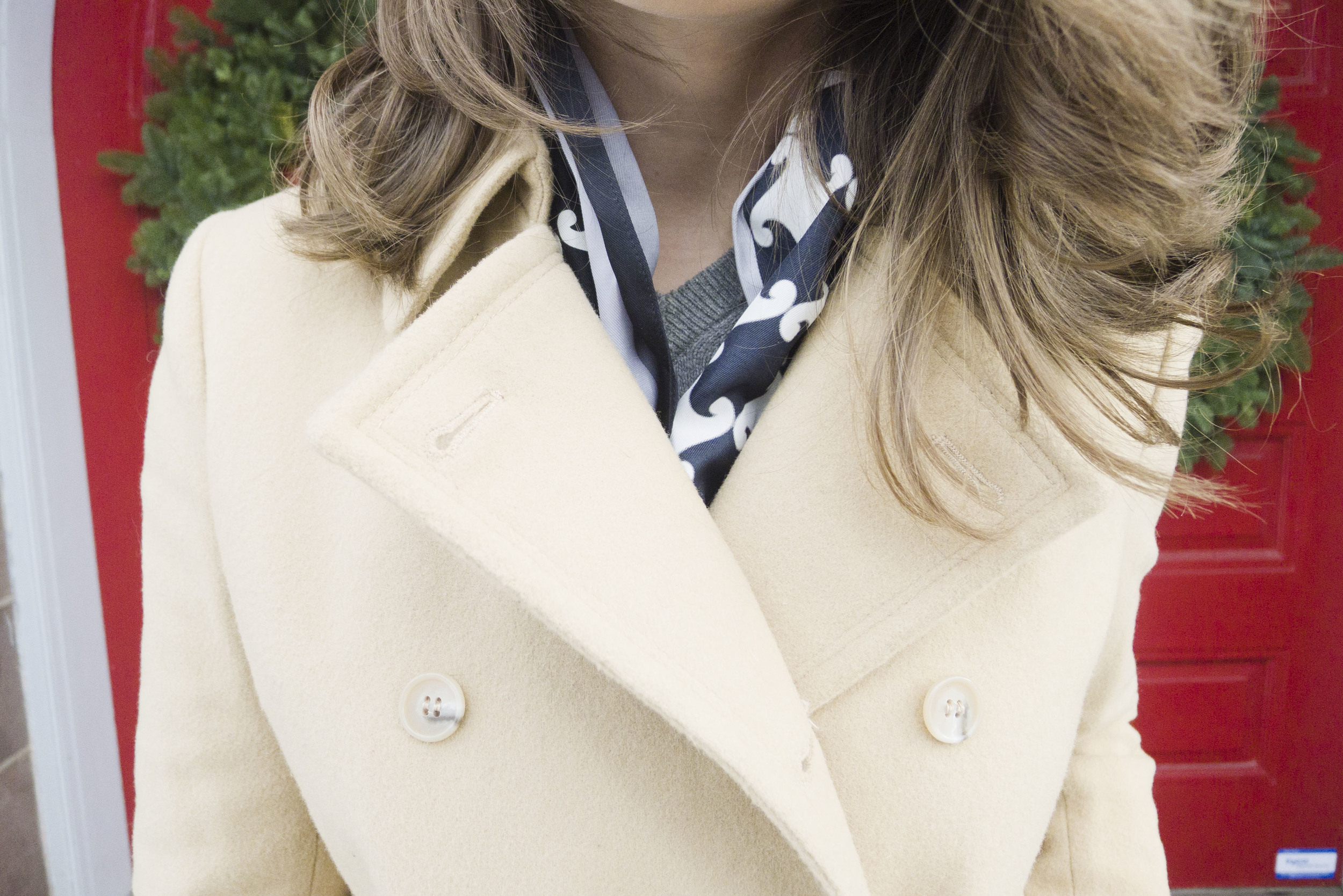 winter wool camel colored coat, black and white scarf