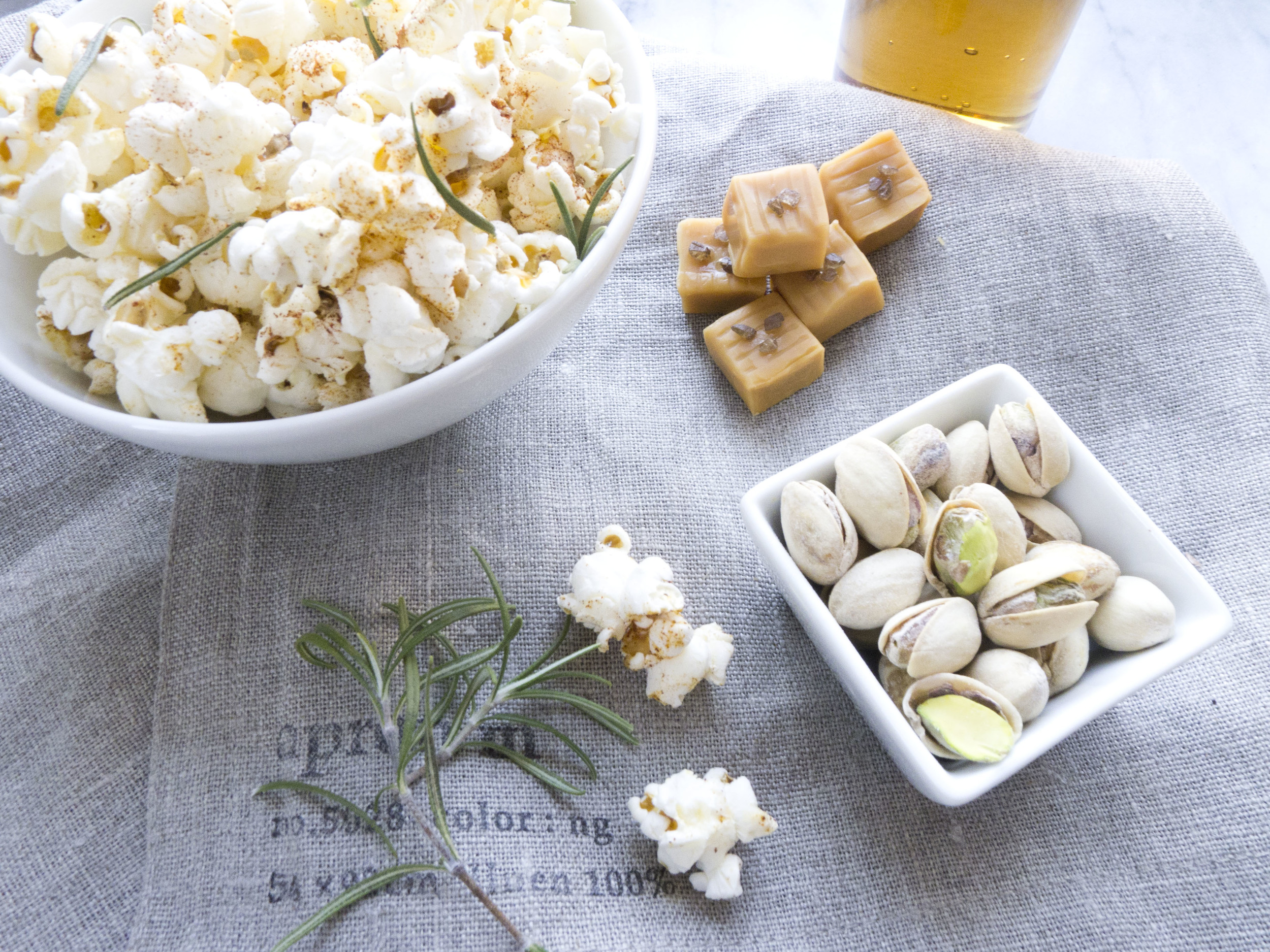 smoked salt caramels, popcorn with chipotle and rosemary, in shell pistachio, cream soda