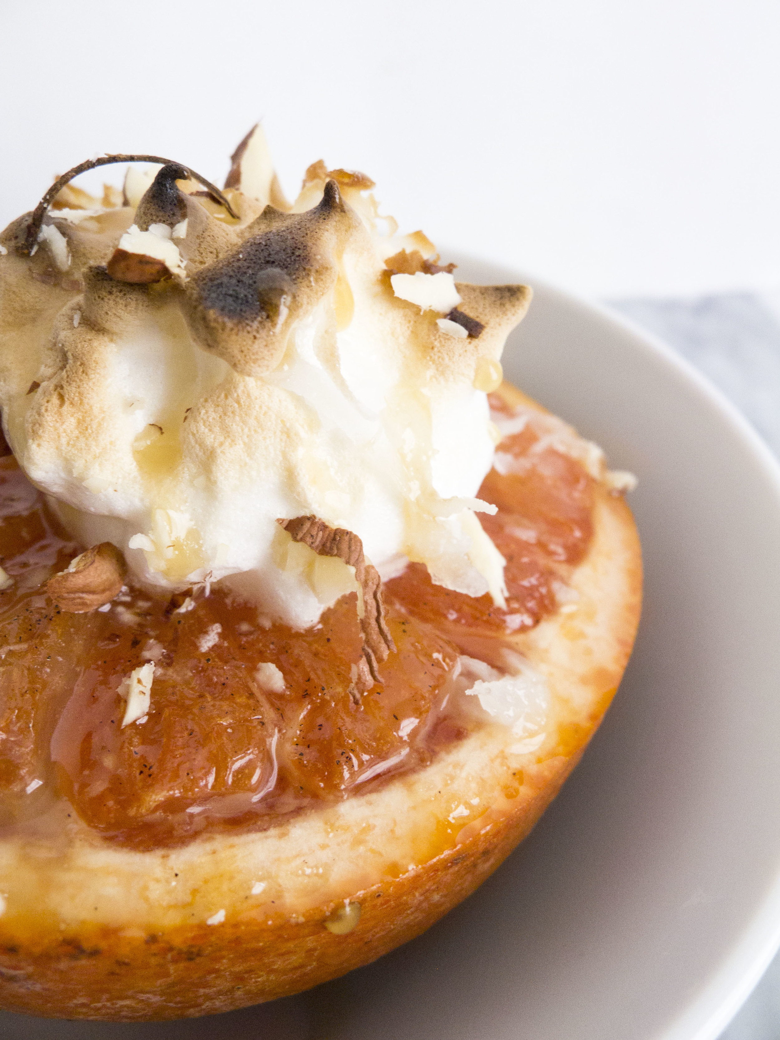 broiled grapefruit meringue with caramel and hazelnuts