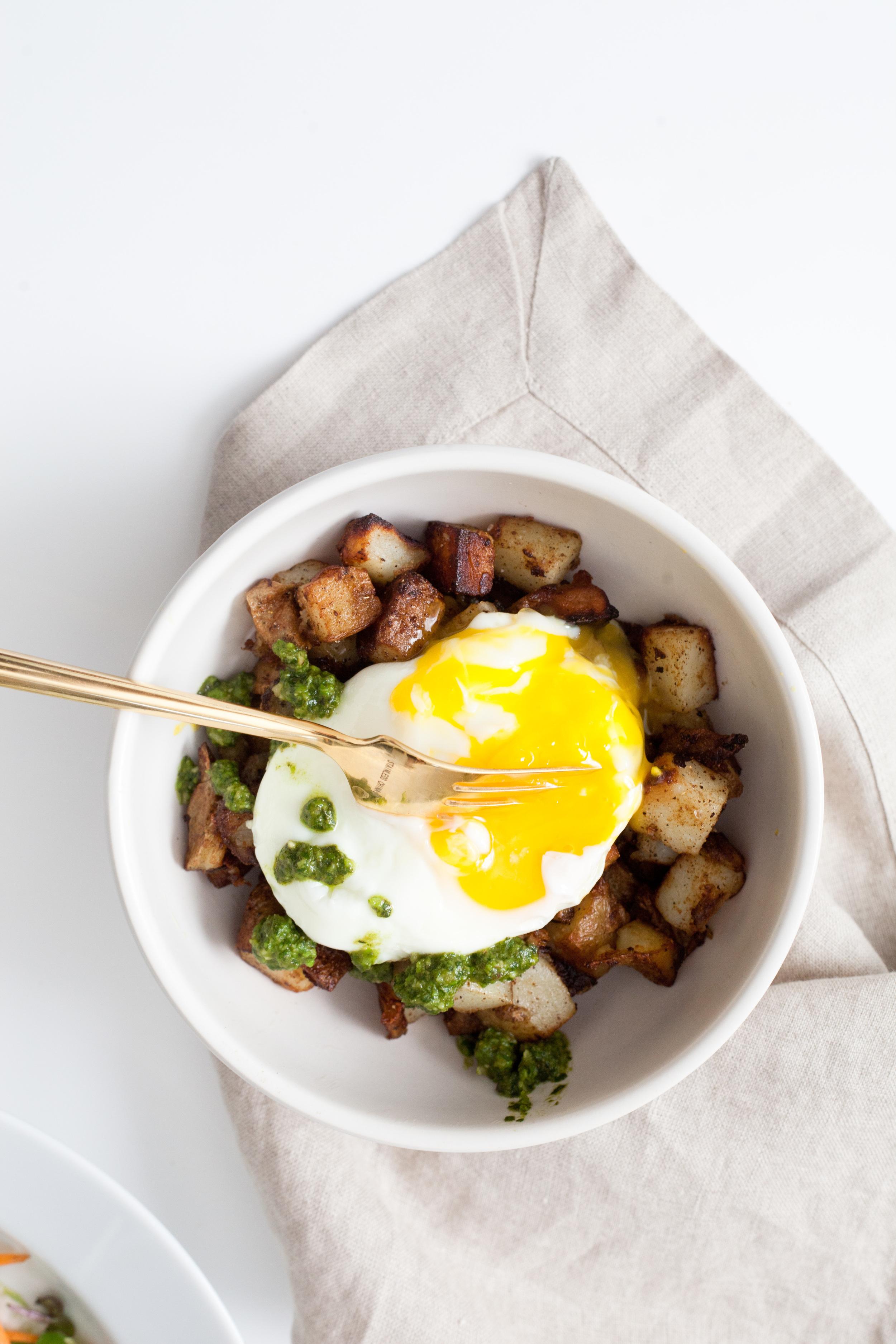 potato hash with eggs and walnut basil pesto