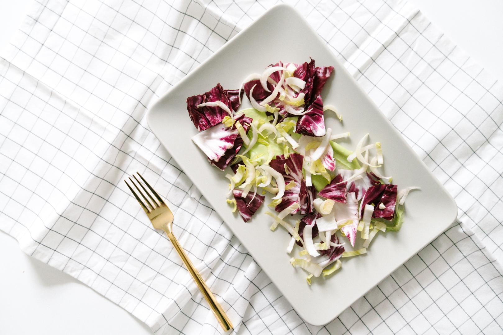 winter bitter greens salad with avocado cream dressing