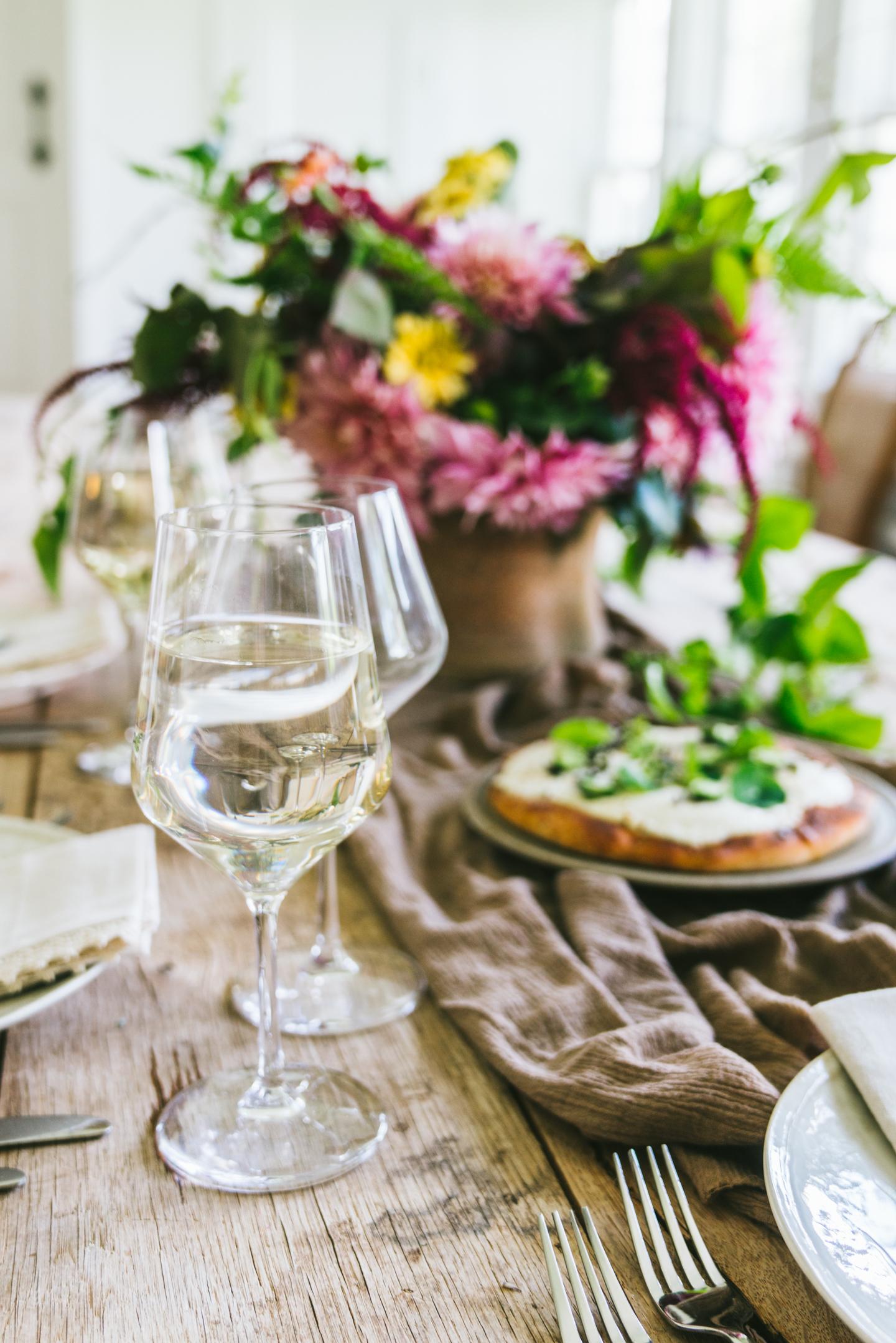 summer white garden pizza with herbs and nasturtium