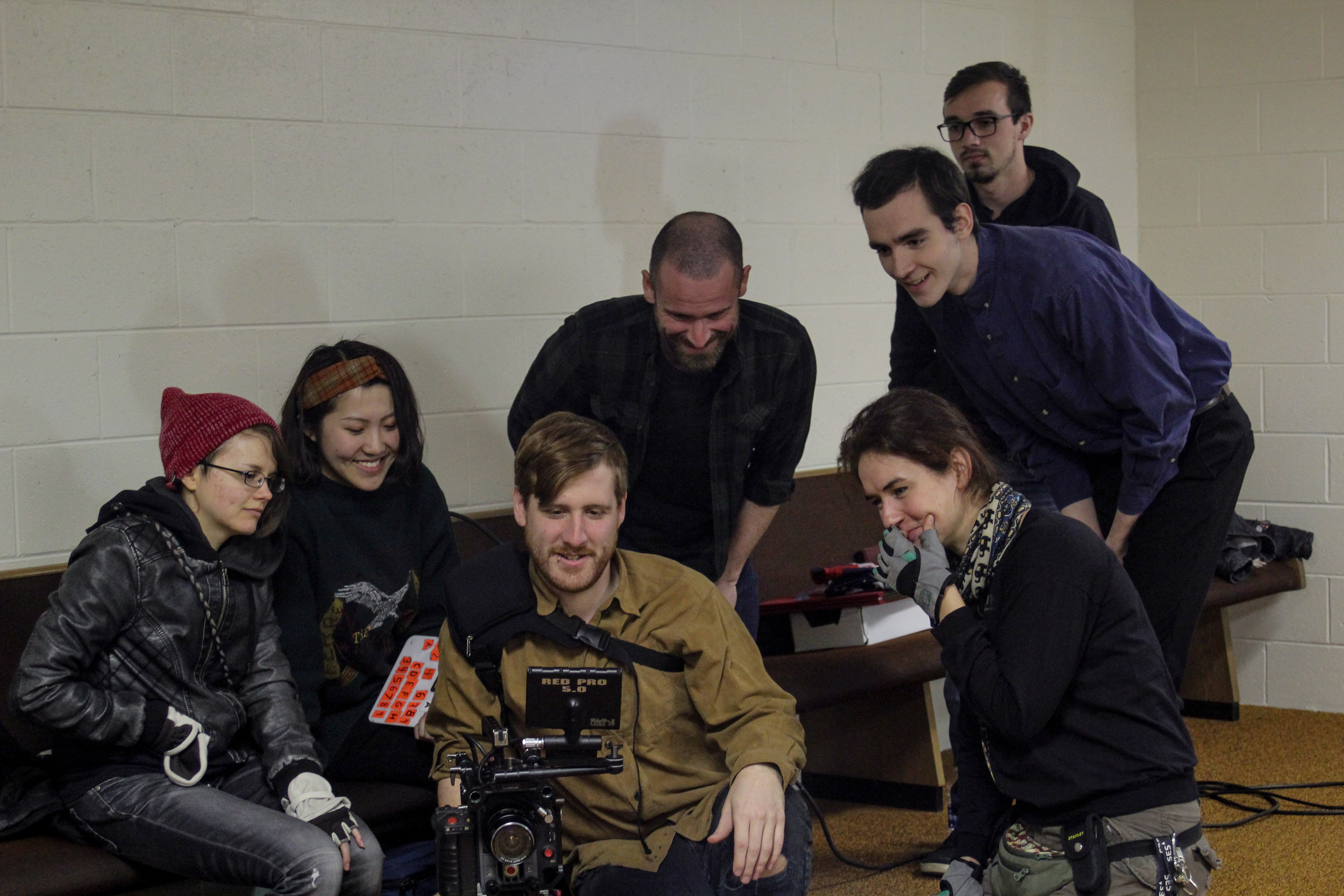 1st AC Tabitha Kennedy (Left), 2nd AC Eve Zhao (2nd Left), DP Jacob Midkiff (Lower Center), Director Graham Holford (Upper Center), PA Tony Shirk (Top Right), Lead Actor Seth Eggenschwiller (Middle Right), and Gaffer Anastasiia Kulikalova (Lower Right) on the set of Pasture, Holford's 2nd year film