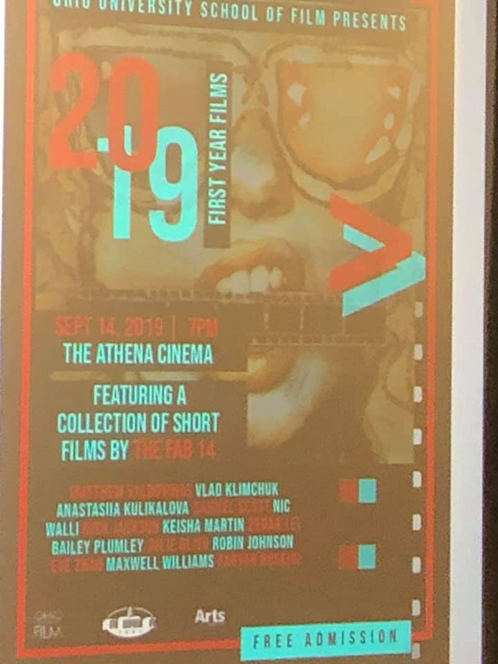 Poster of 1st-Year MFA Films Screening projected on the screen in the Athena Cinema.
