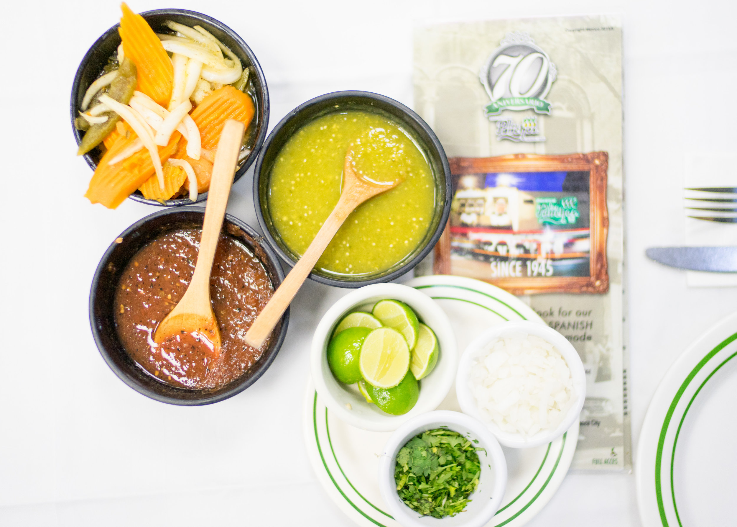 Salsas and condiments that come with every table (the green salsa verde is the spiciest of them all!)