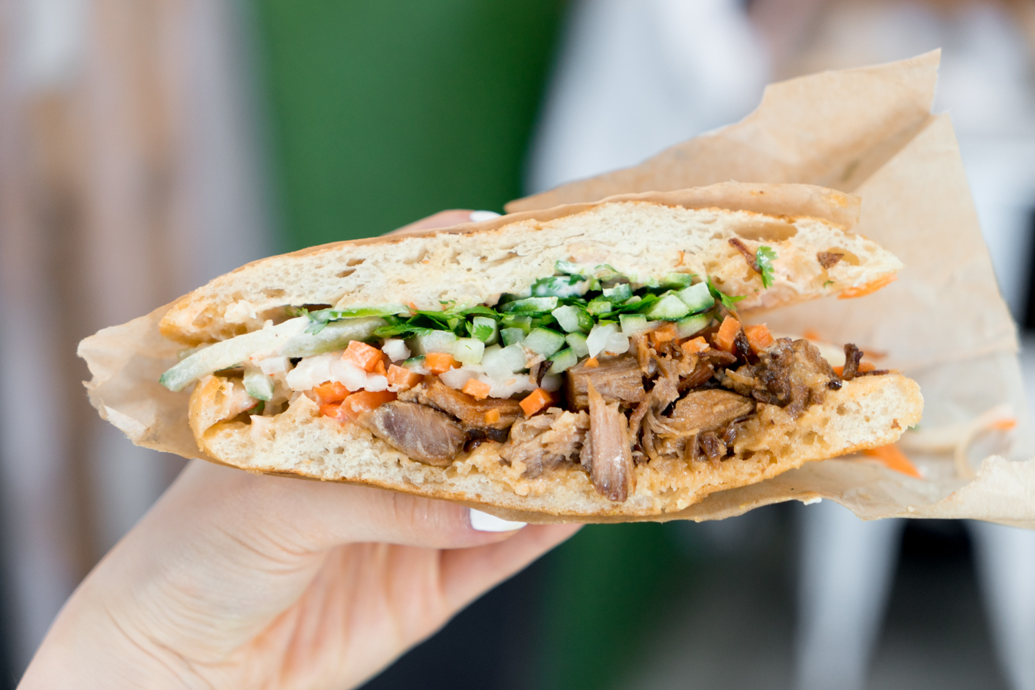 Kurobuta Pork Belly Banh Mi  ($10.95) - playful take on the popular Vietnamese sandwich with braised, caramelized Kurobuta pork belly, housemade pickled daikon & carrots, cilantro, cucumbers, jalapenos, chili aioli on panini-pressed ciabatta