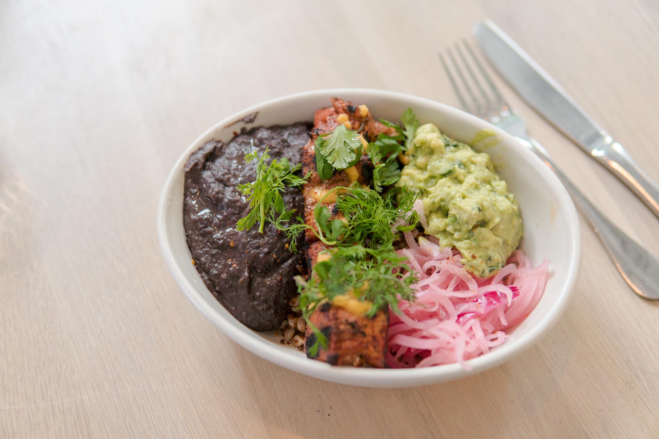 Albacore Tuna Achiote - black bean, pickled onions, avocado, grains, habanero salsa ($19)