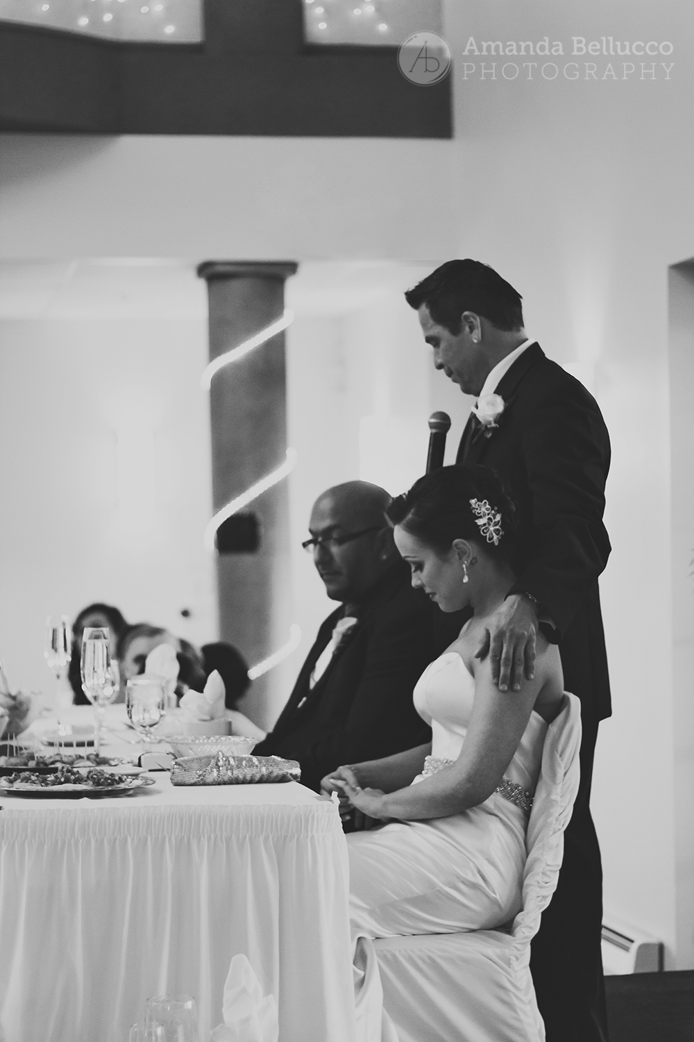 The bride and groom receive a toast during their reception at the Italian American Community Center.