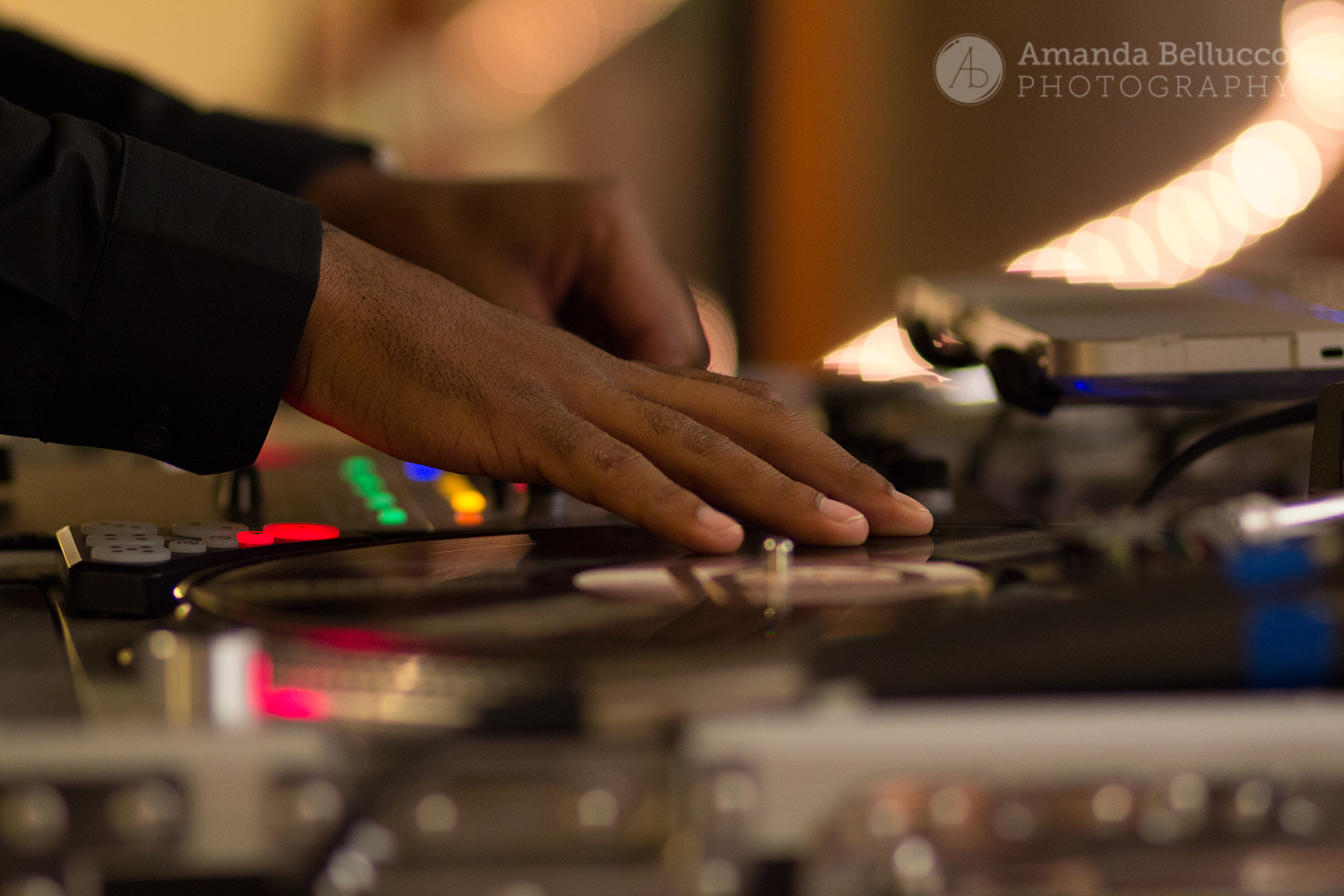 The DJ scratching during the reception at the Italian American Community Center.