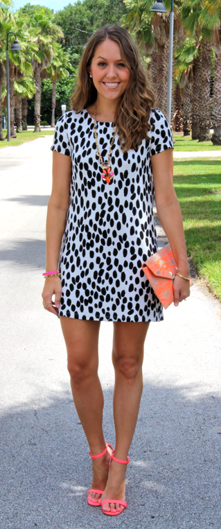 Animal print dress with neon accessories