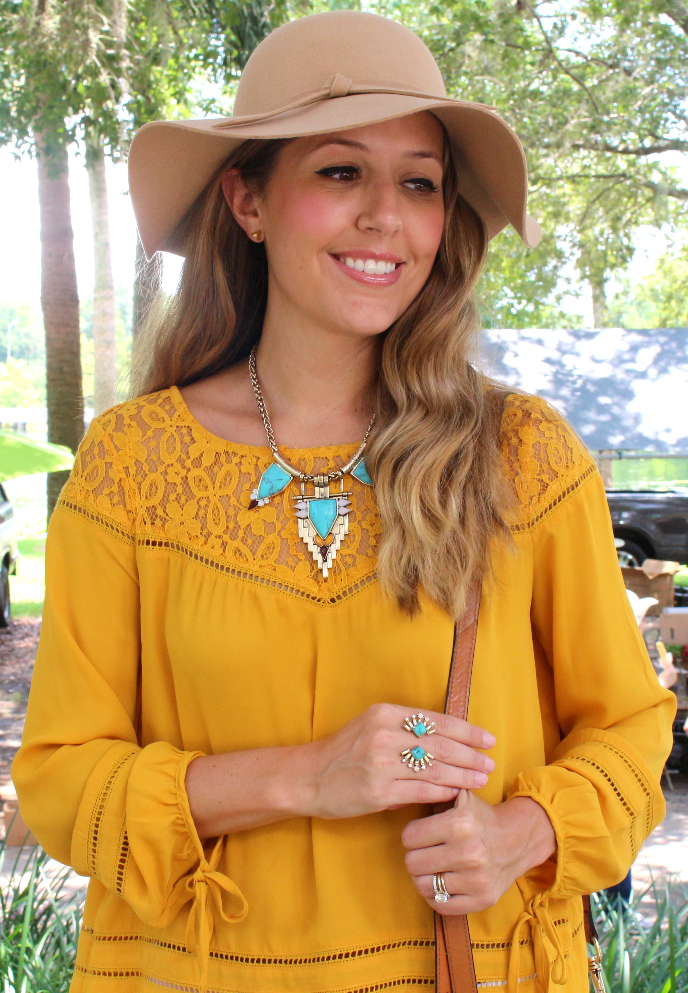 Mustard top with turquoise jewelry
