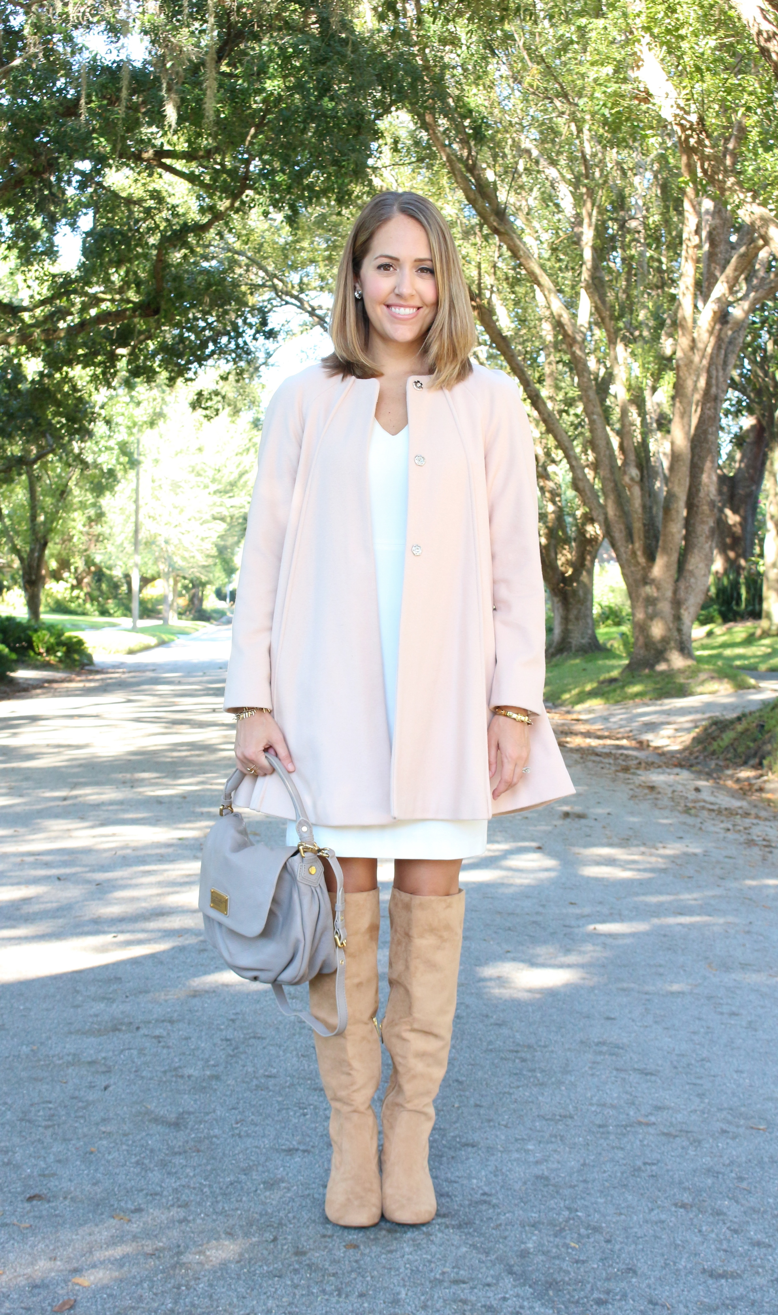 Pink wool coat, taupe boots, white dress