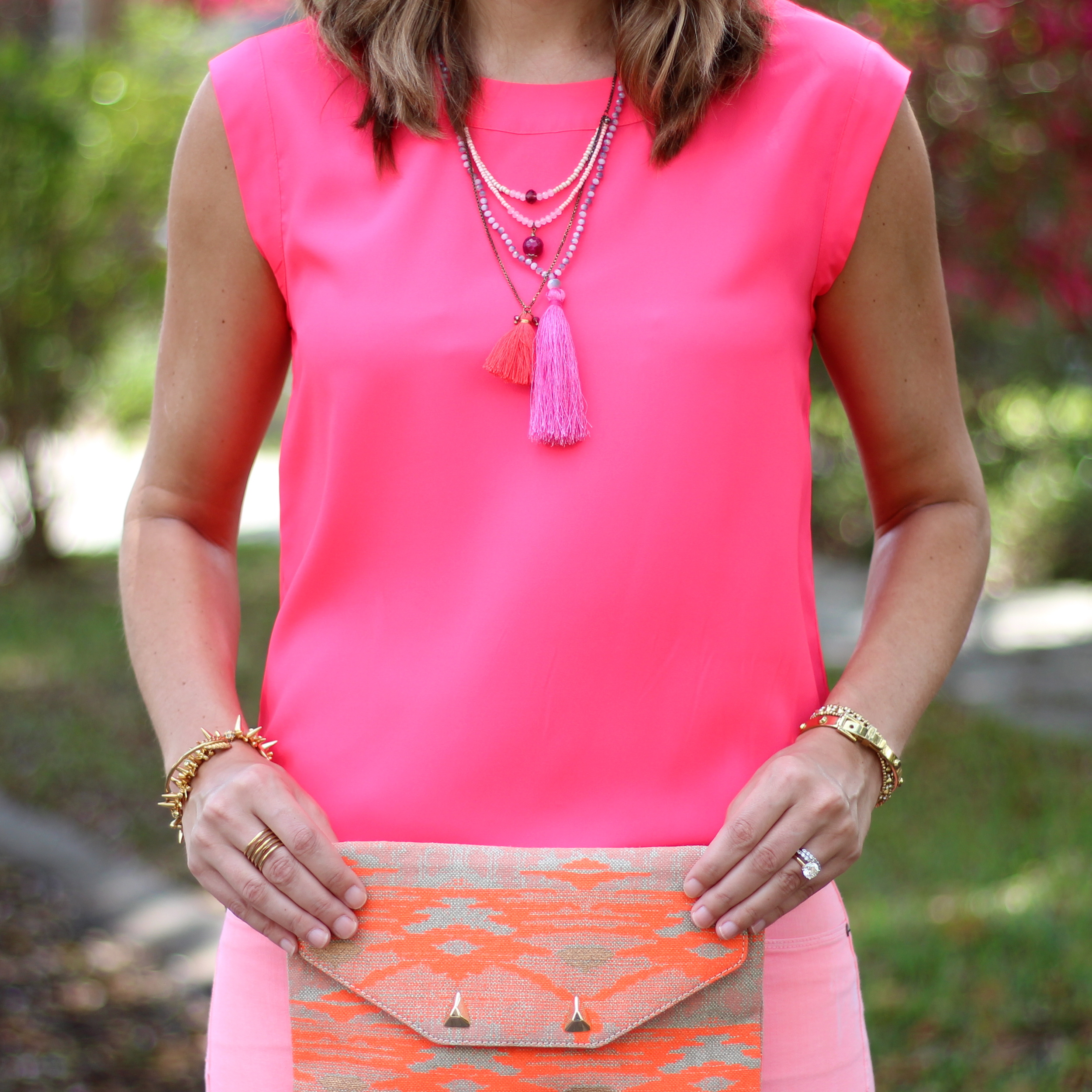 Neon pink, tassel necklace, coral jeans