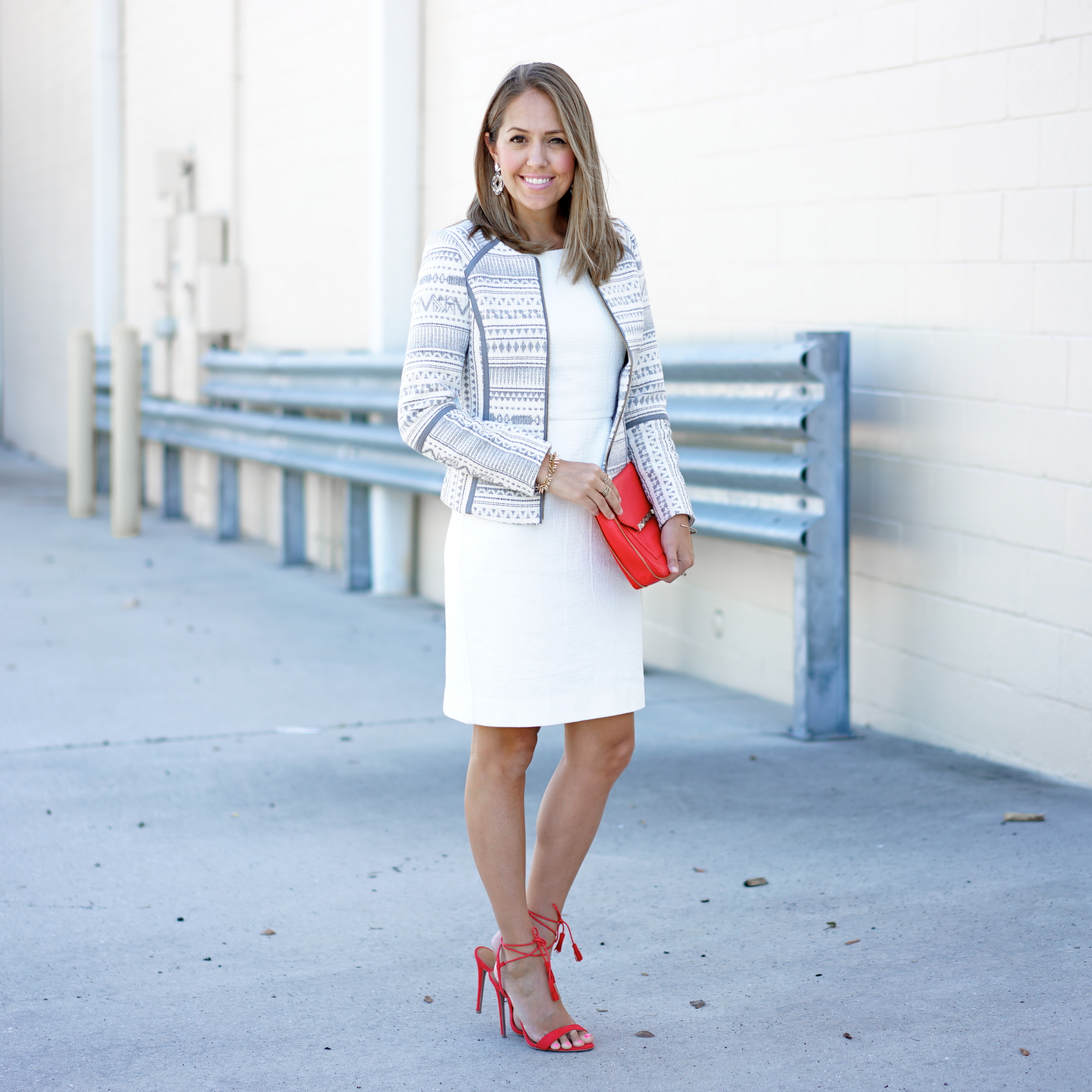 Patterned jacket, white dress, red heels