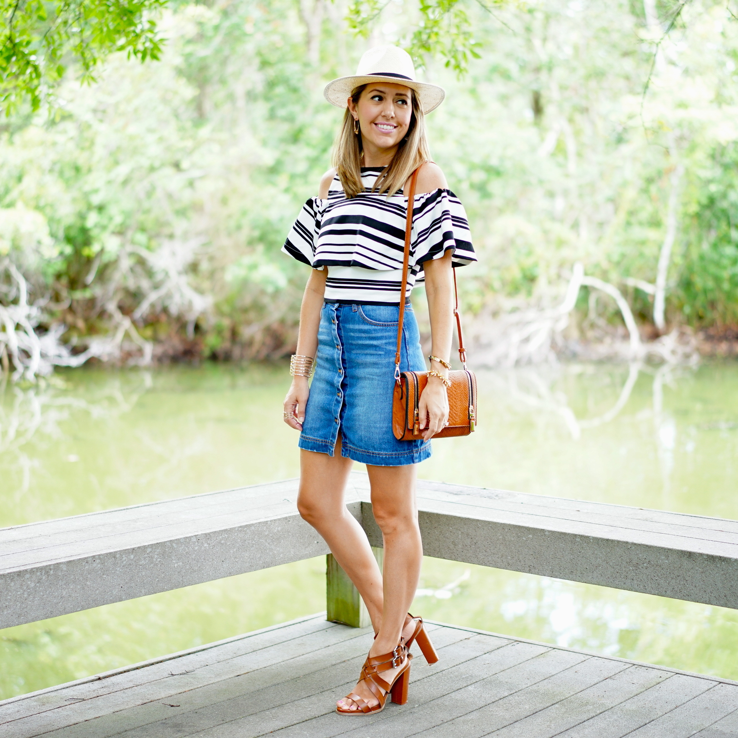 Striped ruffle top, denim skirt, cognac shoes