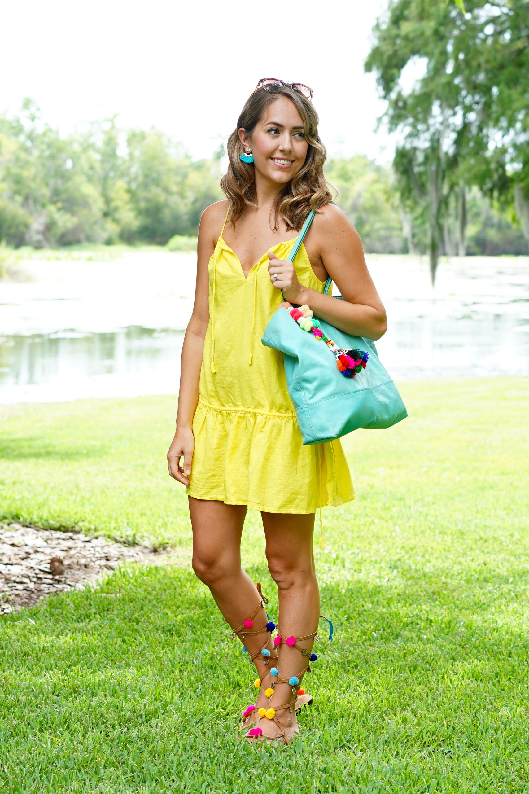 Yellow dress, turquoise bag