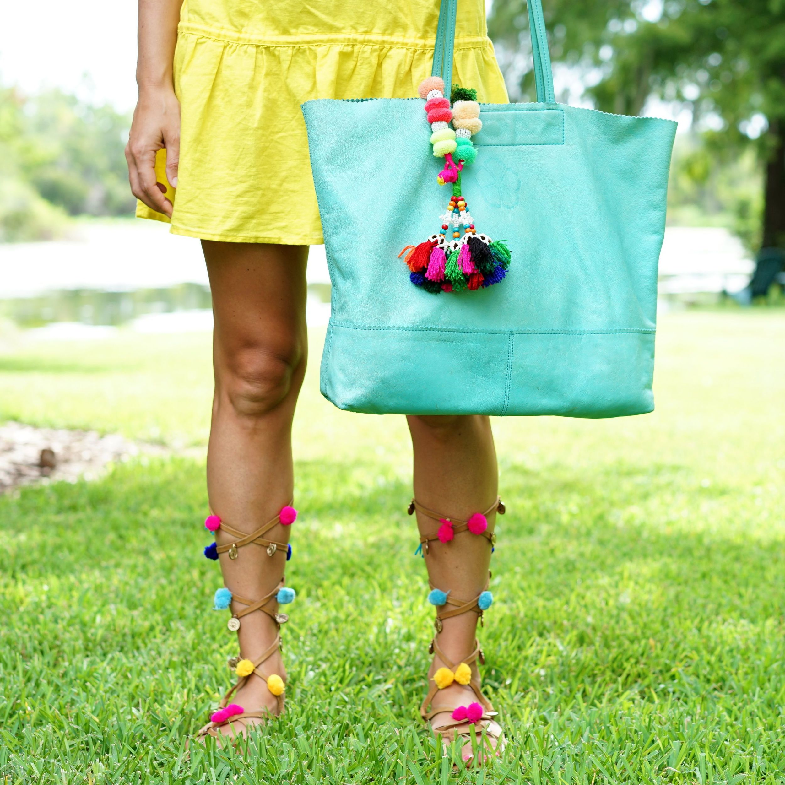 Yellow dress, pom pom sandals, turquoise bag