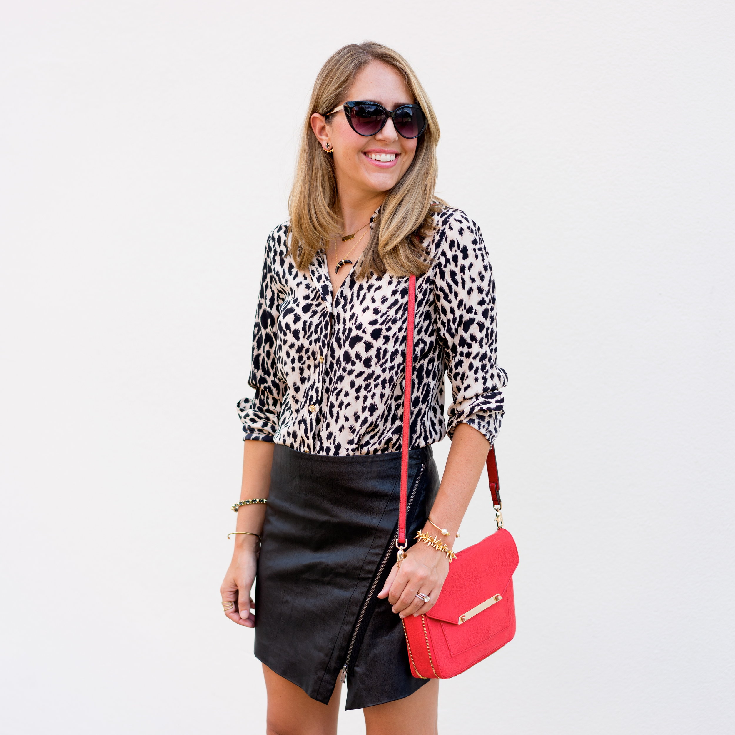 Leopard top, leather skirt, red purse