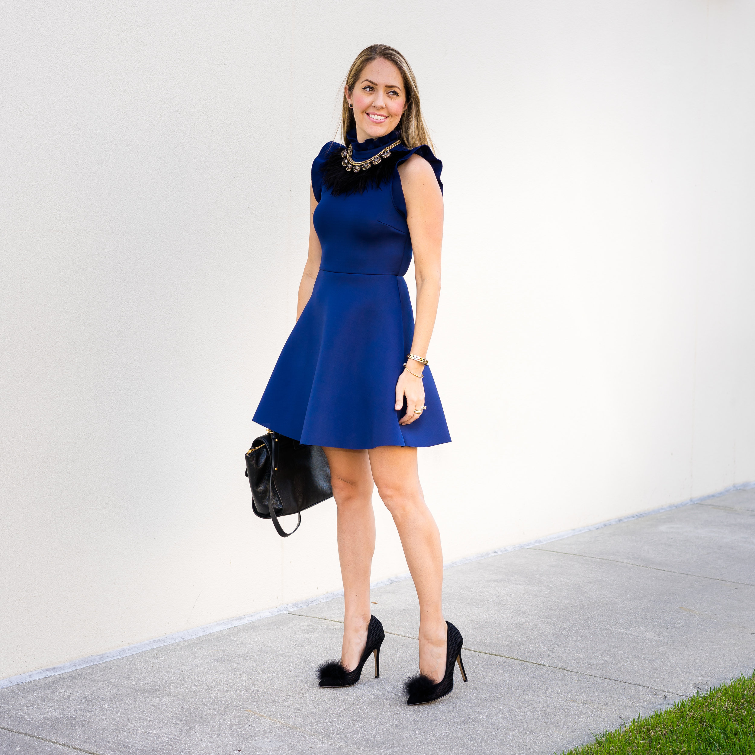 Navy dress, black feather necklace, Betsey Johnson feather pumps