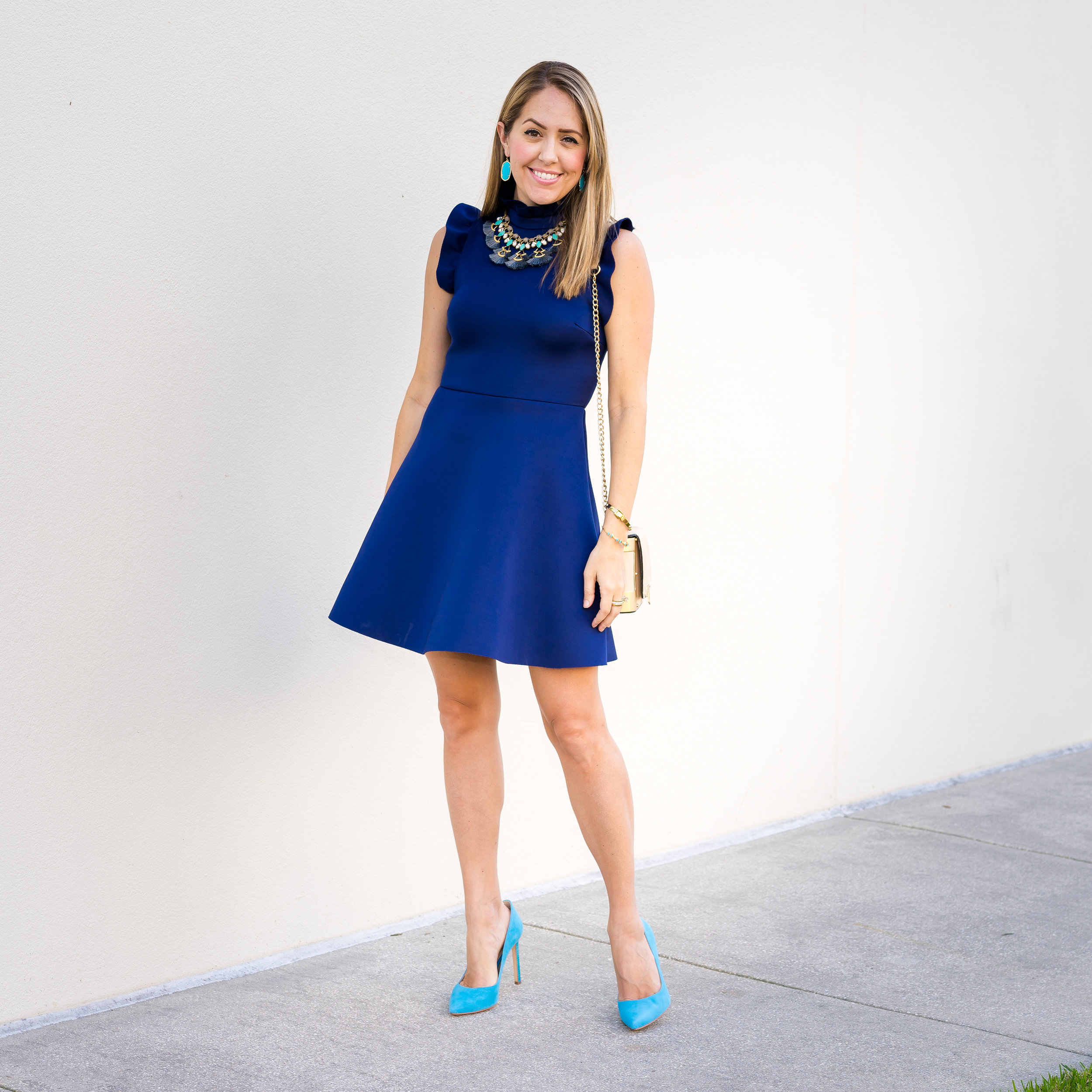 Navy dress, turquoise earrings and pumps