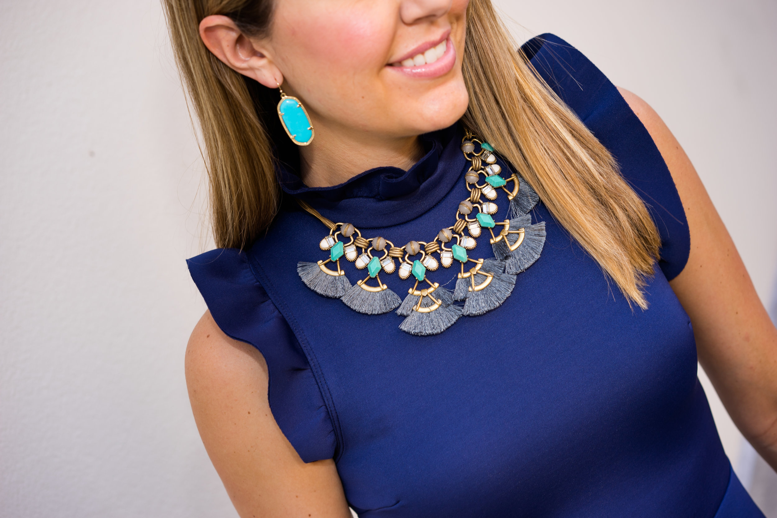 Navy dress, tassel Stella Dot necklace, turquoise Kendra Scott earrings
