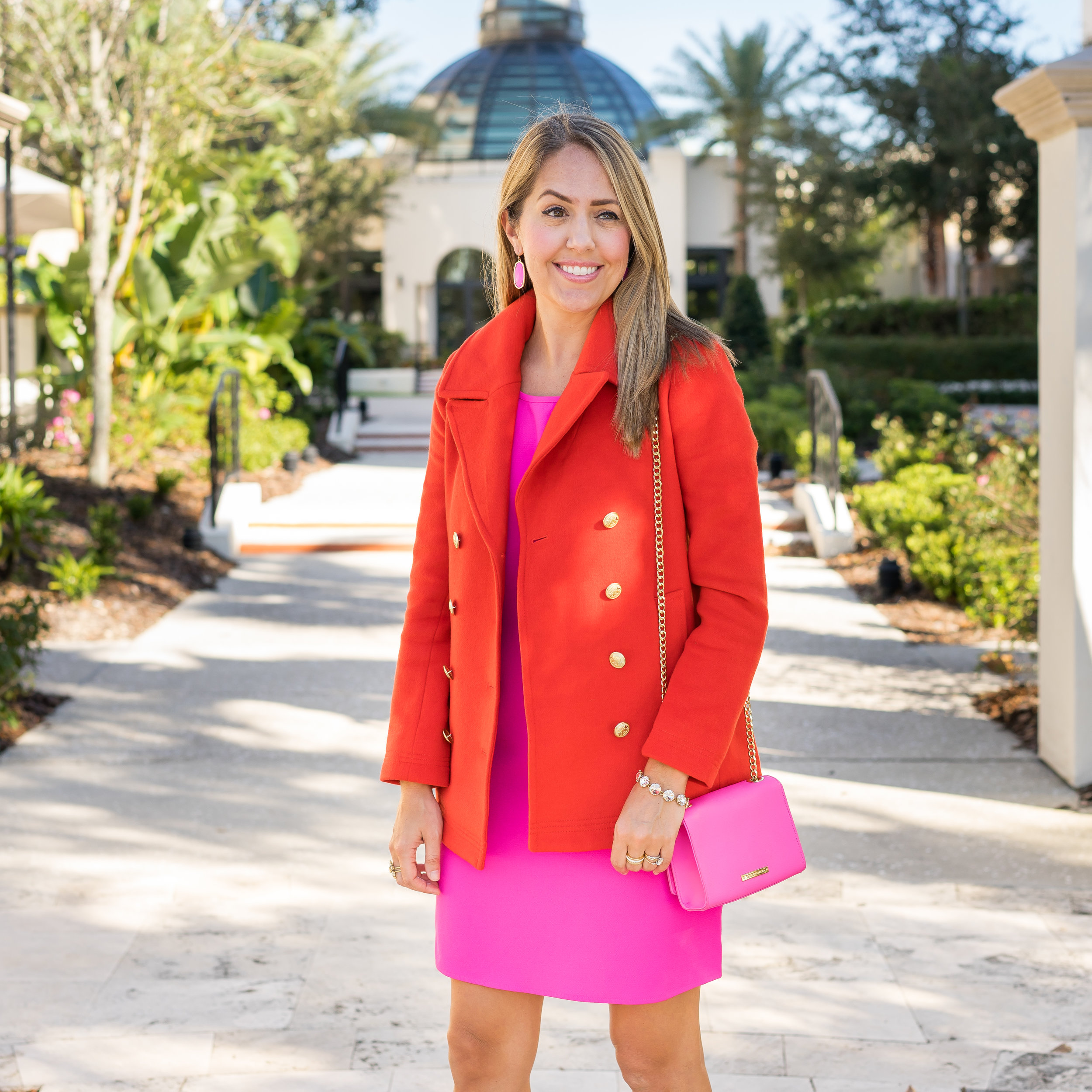 Red coat with hot pink dress and purse