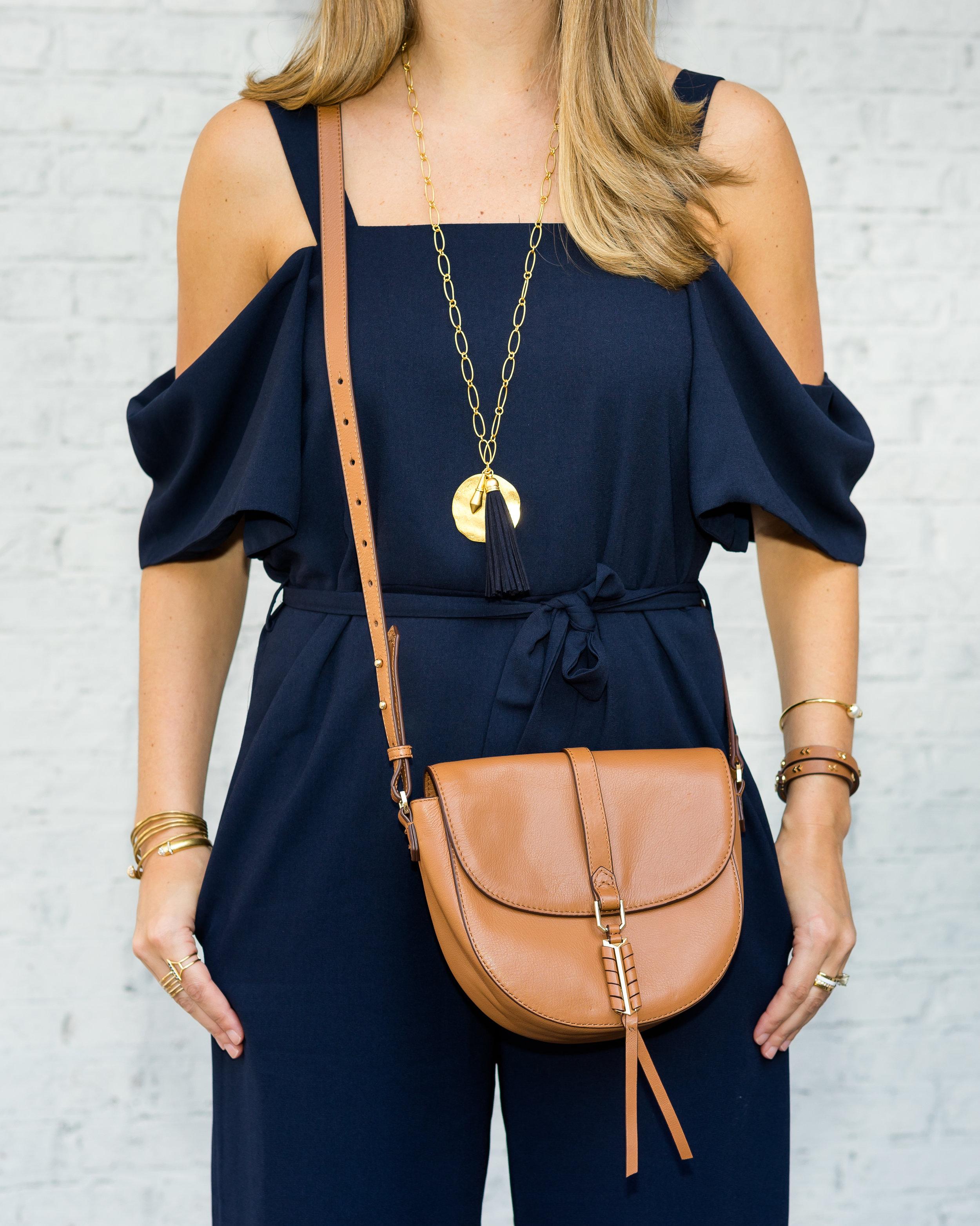 Navy cold shoulder jumpsuit, Covet purse, navy tassel necklace