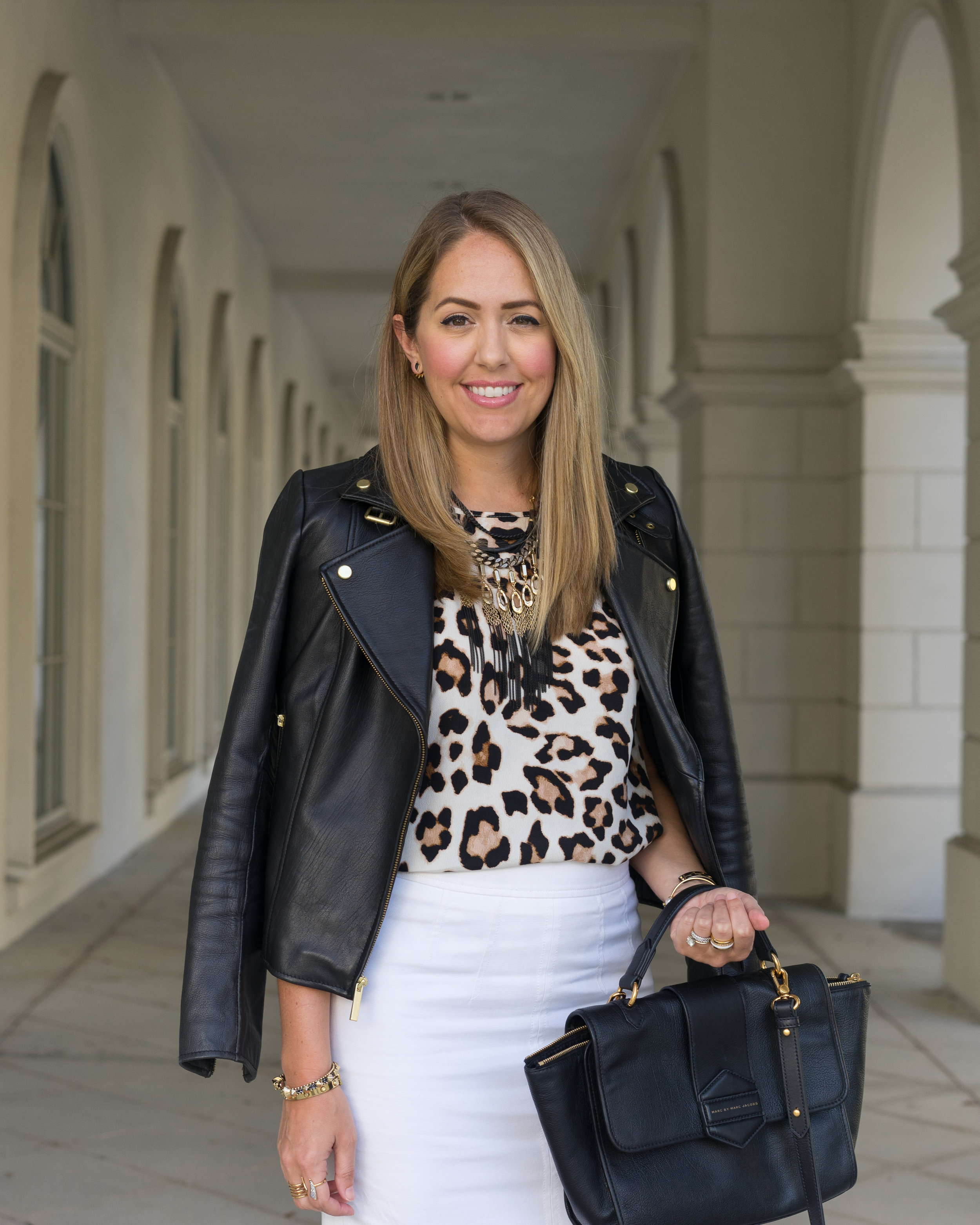 Black leather jacket, leopard top, white skirt
