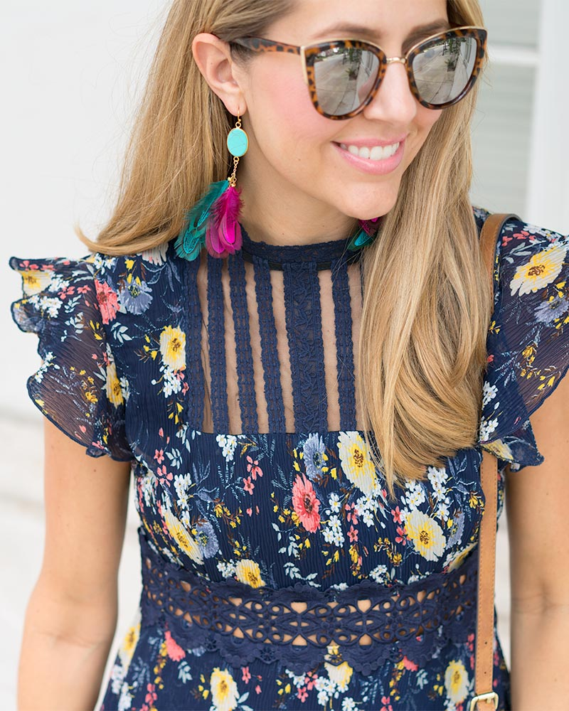 Navy floral dress, feather earrings