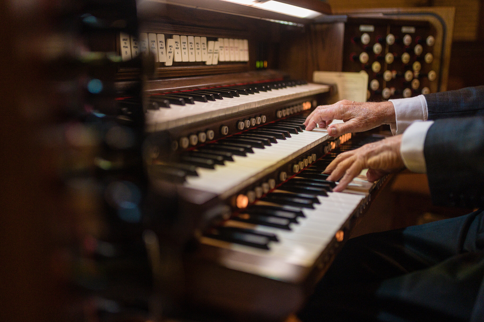 An organist provides music for a COVID elopement ceremony