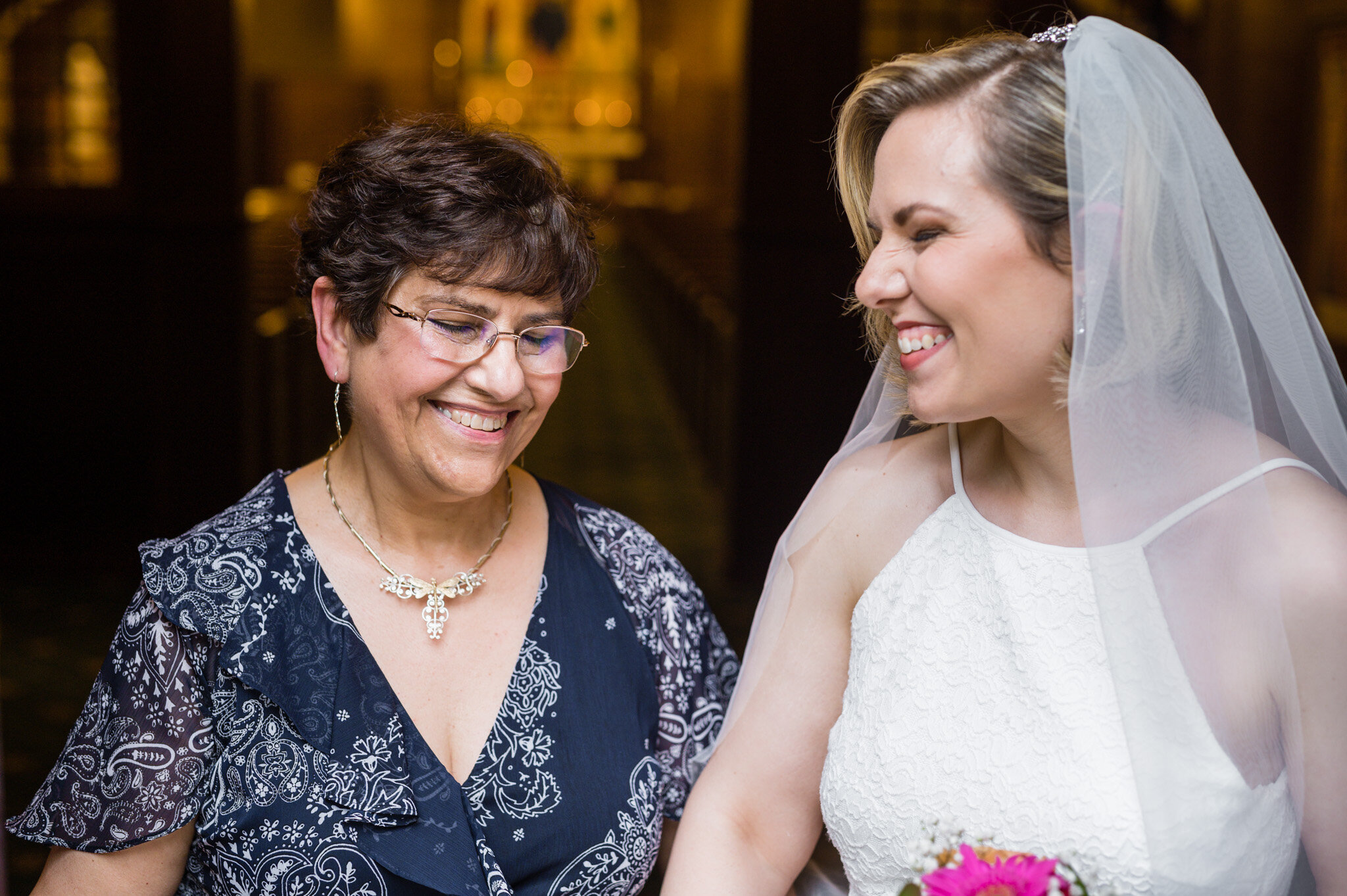 Mother and daughter sharing a moment together on her wedding day