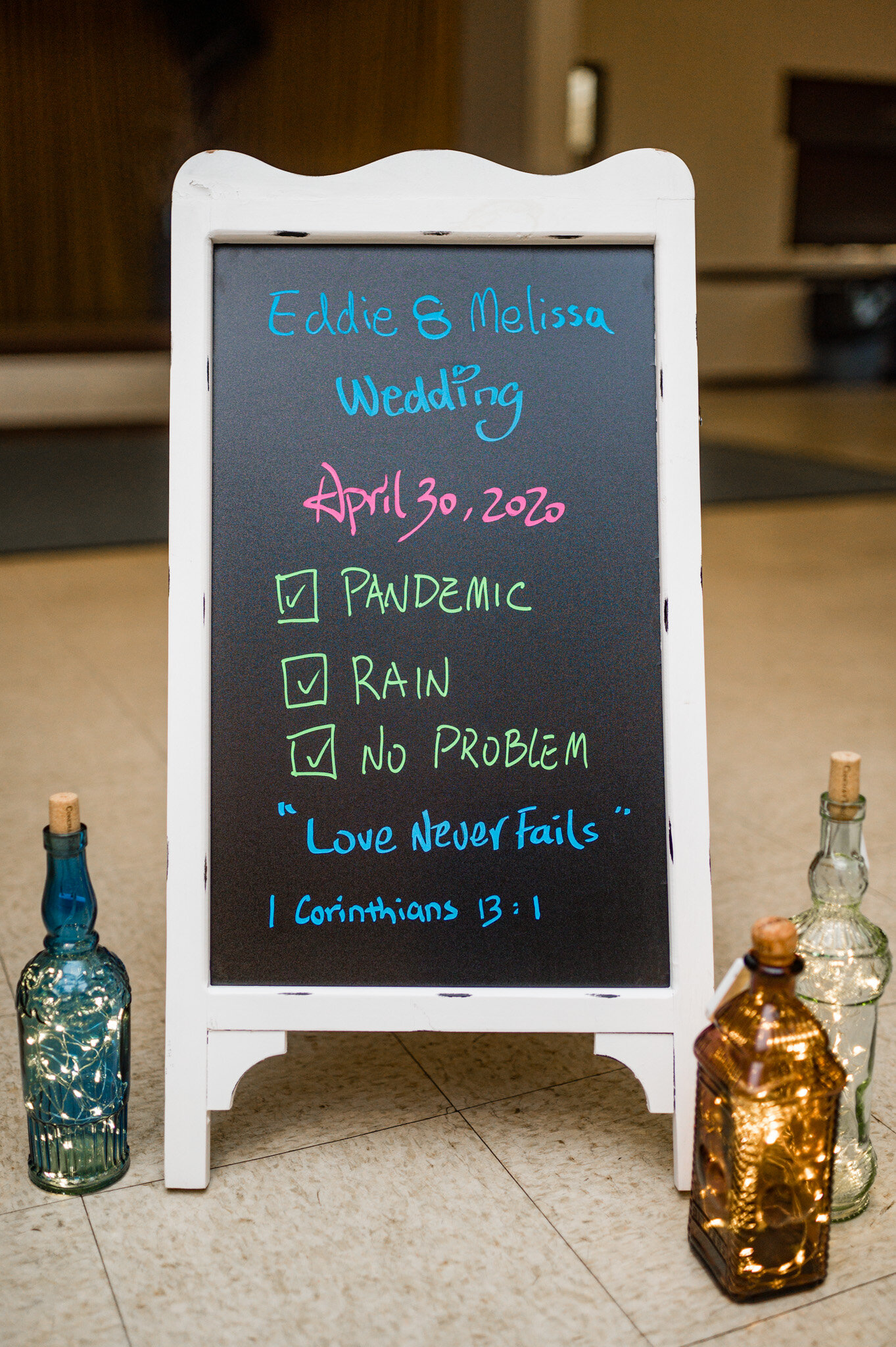Wedding reception sign tells about the challenges of COVID and rain