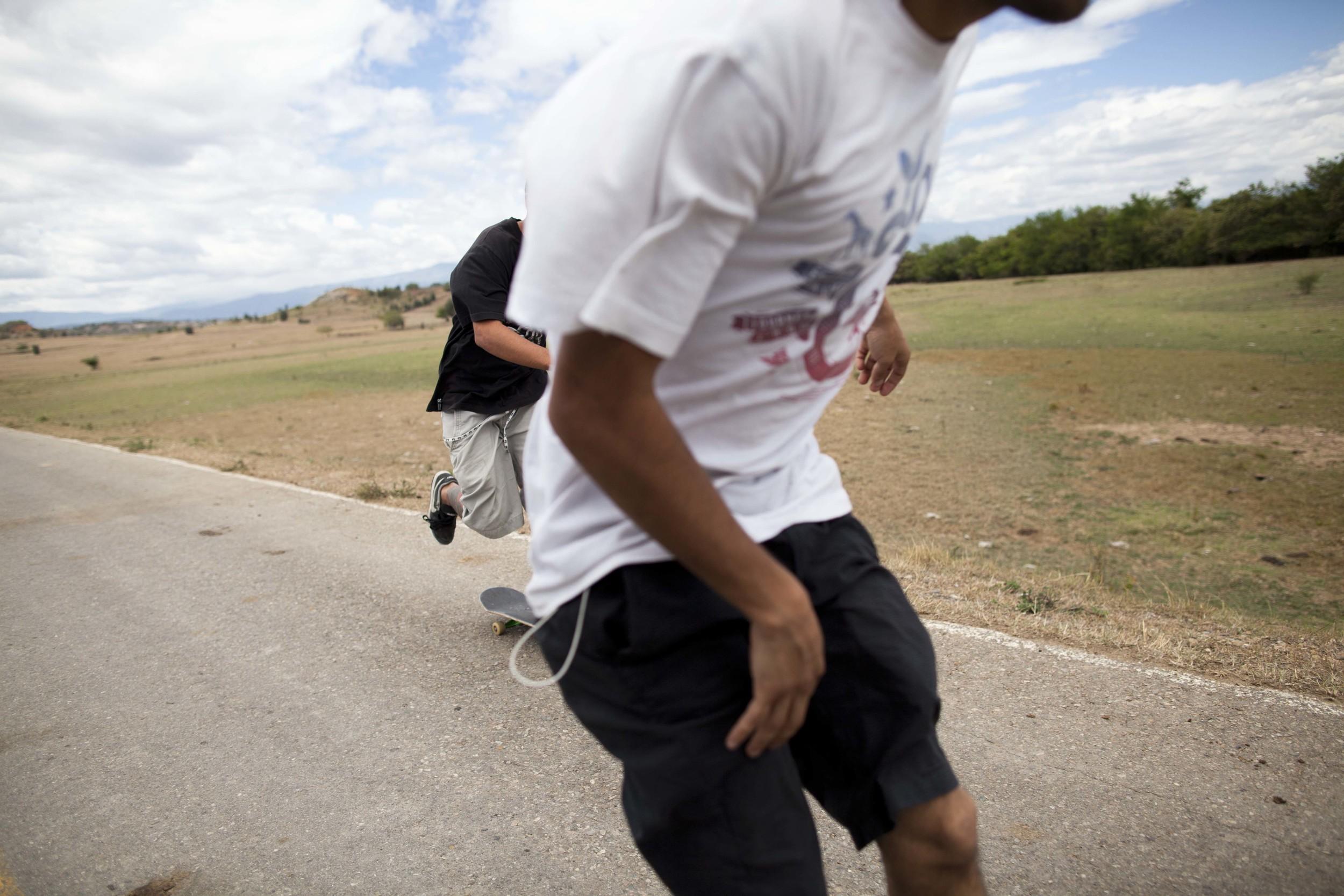Tatacoa Desert. 31 July 2012. Felipe and his friend Manuel skateboarding in the vastness of the Tatacoa Desert.