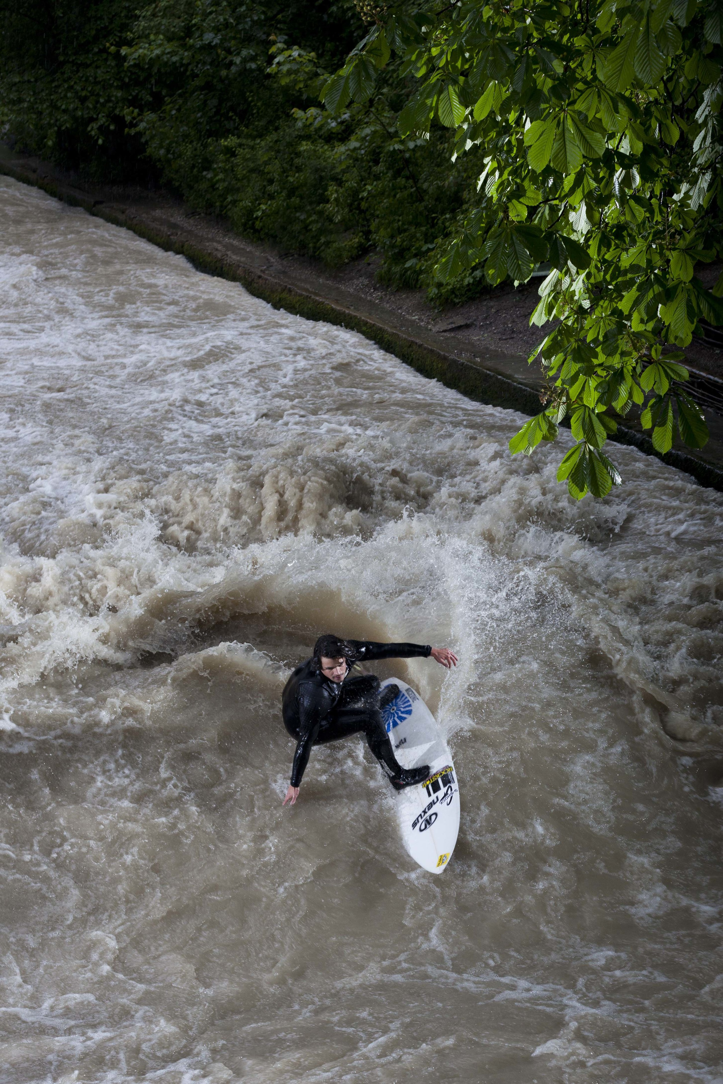 GERMANY. Munich. June 2013. Pro surfer   Steve Ratzisberger     at the Eisbach.