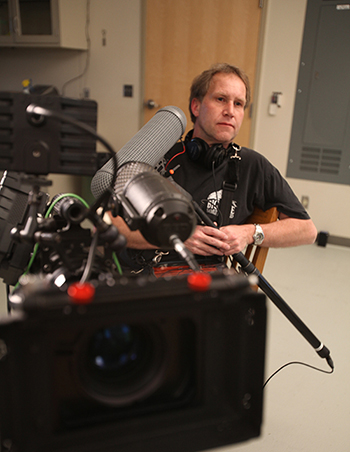 "Taking a break behind a Red One camera rig on the National Geographic production ""The Man Who Can Fly."""