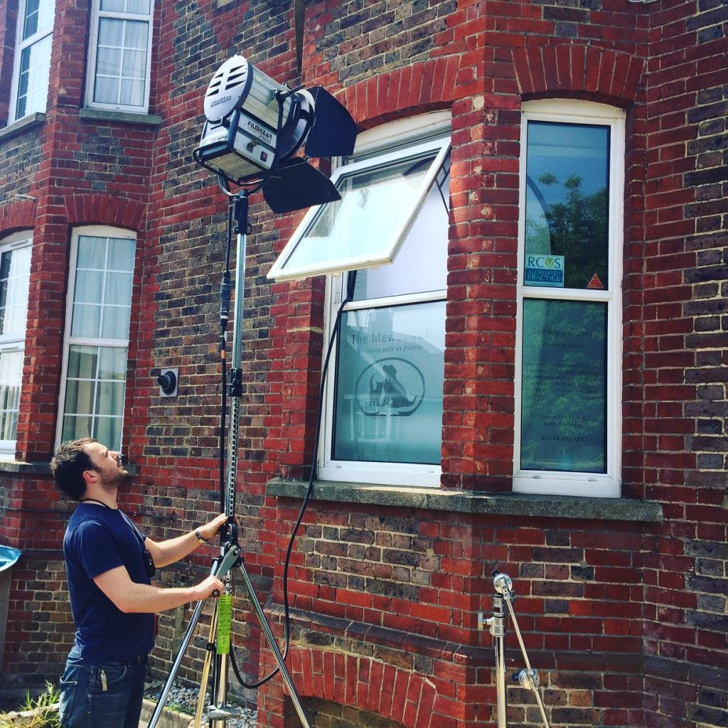 On set for  325productionsUK  using an HMI to act as the sun for an interior scene.