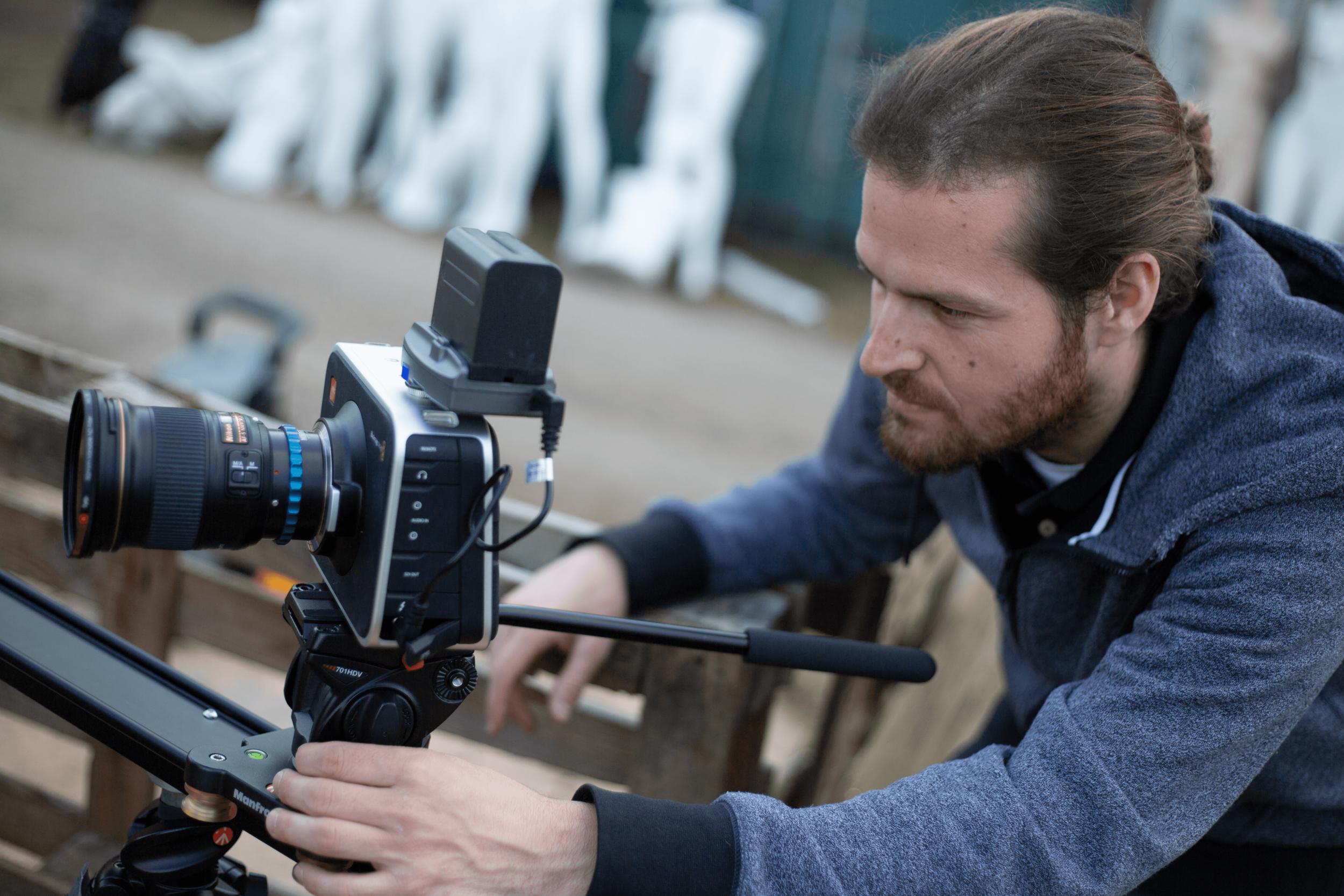 daniel kutcher operating camera.png