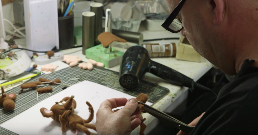Director Trevor Hardy making a puppet for the film
