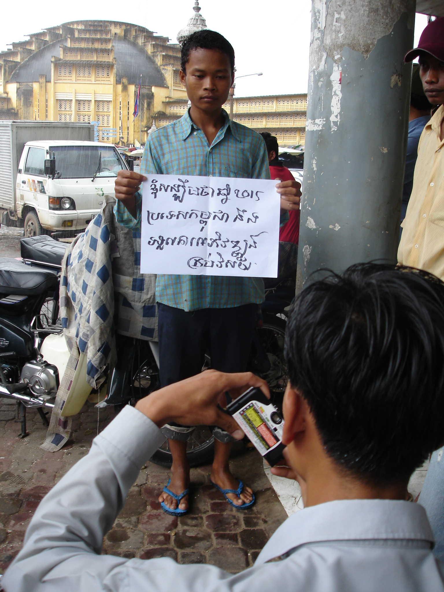 Boy conducting photo research, Phnom Penh