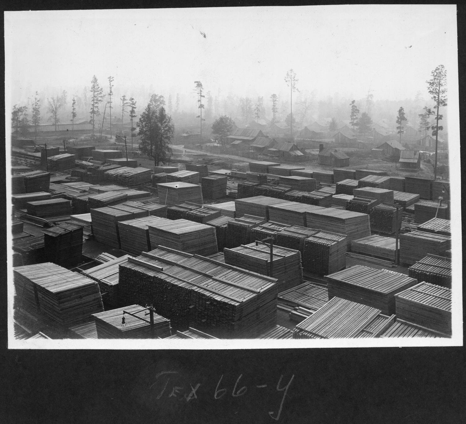 Tex66 Lumber Yard with Housing in Background